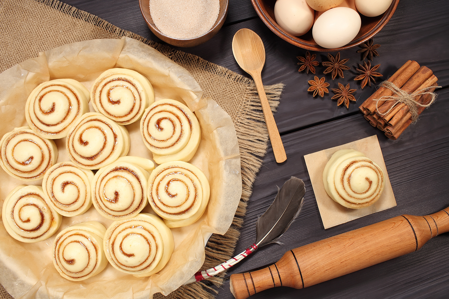 Set of 11 photos - raw buns: cinnamon rolls prepared for baking on a background of rustic table example image 15