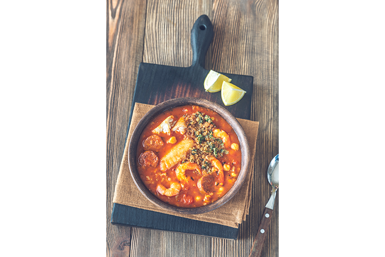 Portion of spanish fish and chorizo soup example image 1