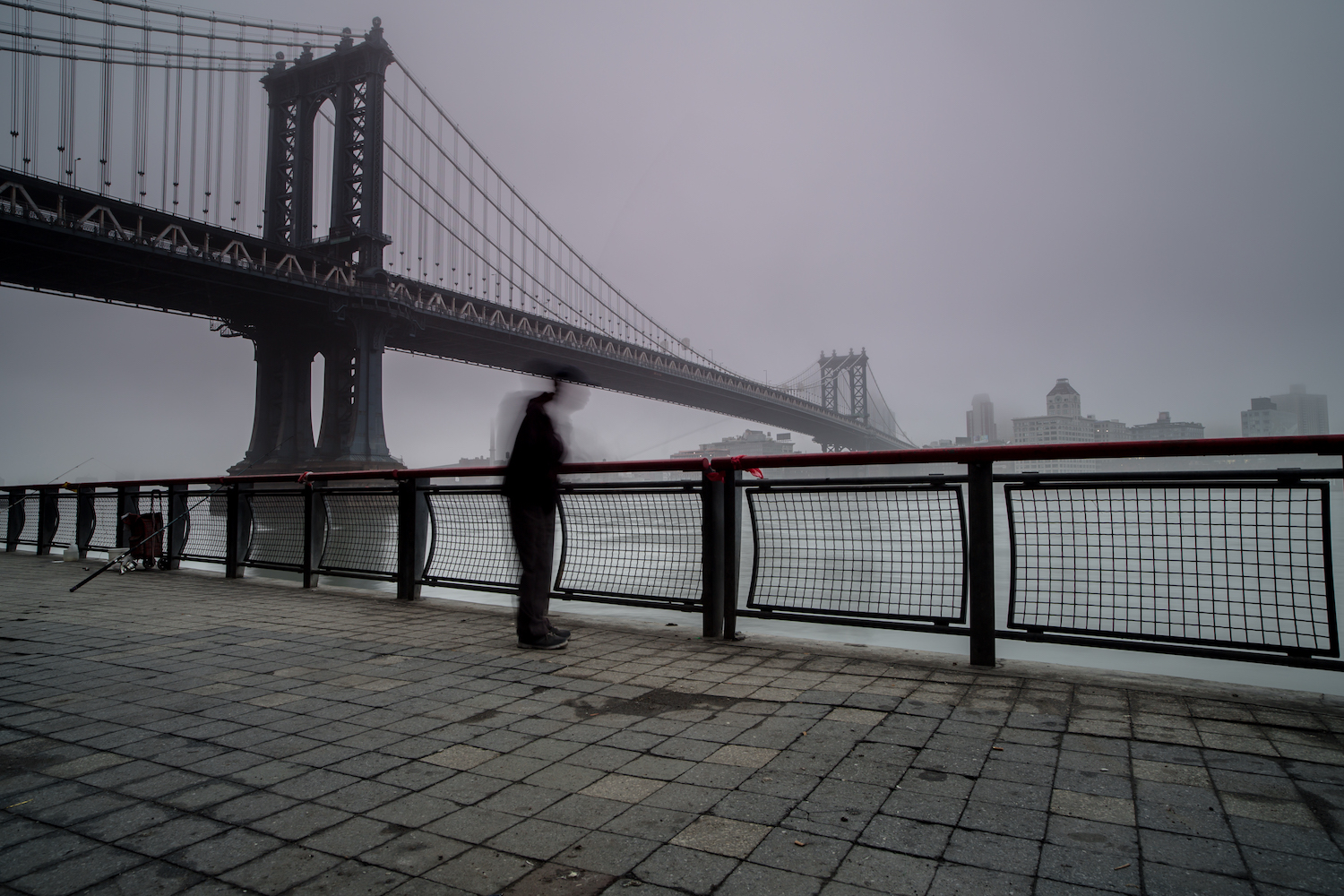 Man fishing in hudson river on a foggy morning example image 1