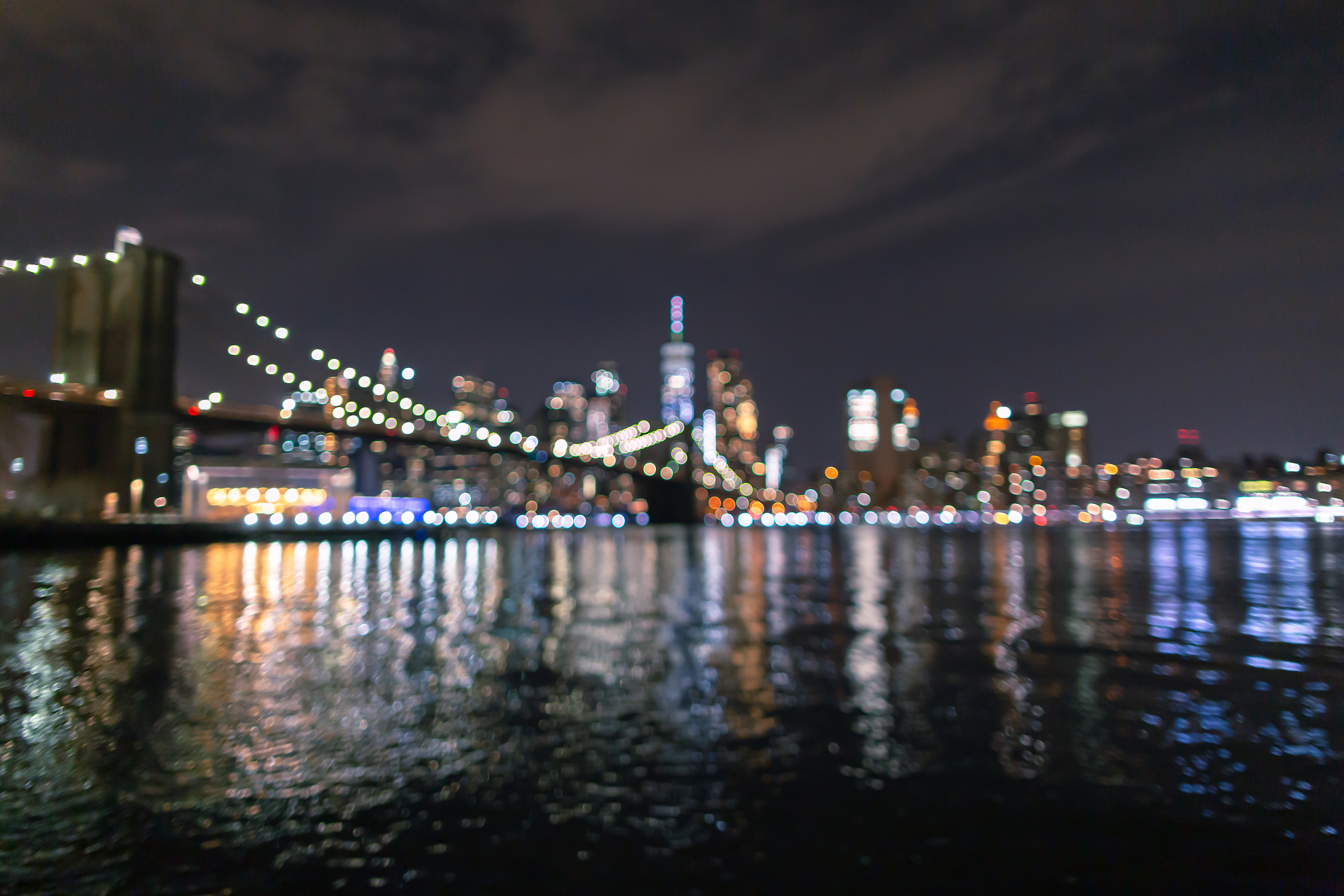 Blurred view of Financial District at night from East River example image 1