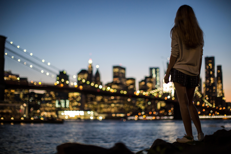 Women enjoying manhattan night view example image 1