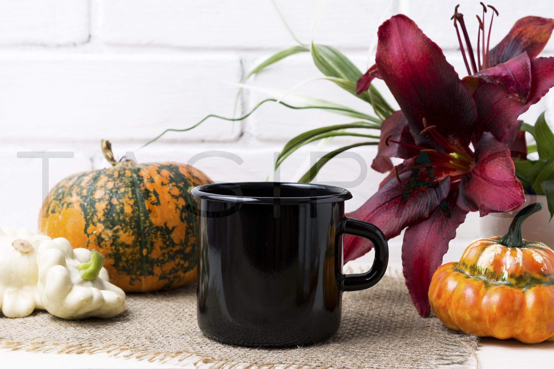 Black campfire enamel mug mockup with pumpkin and red lily. example image 2