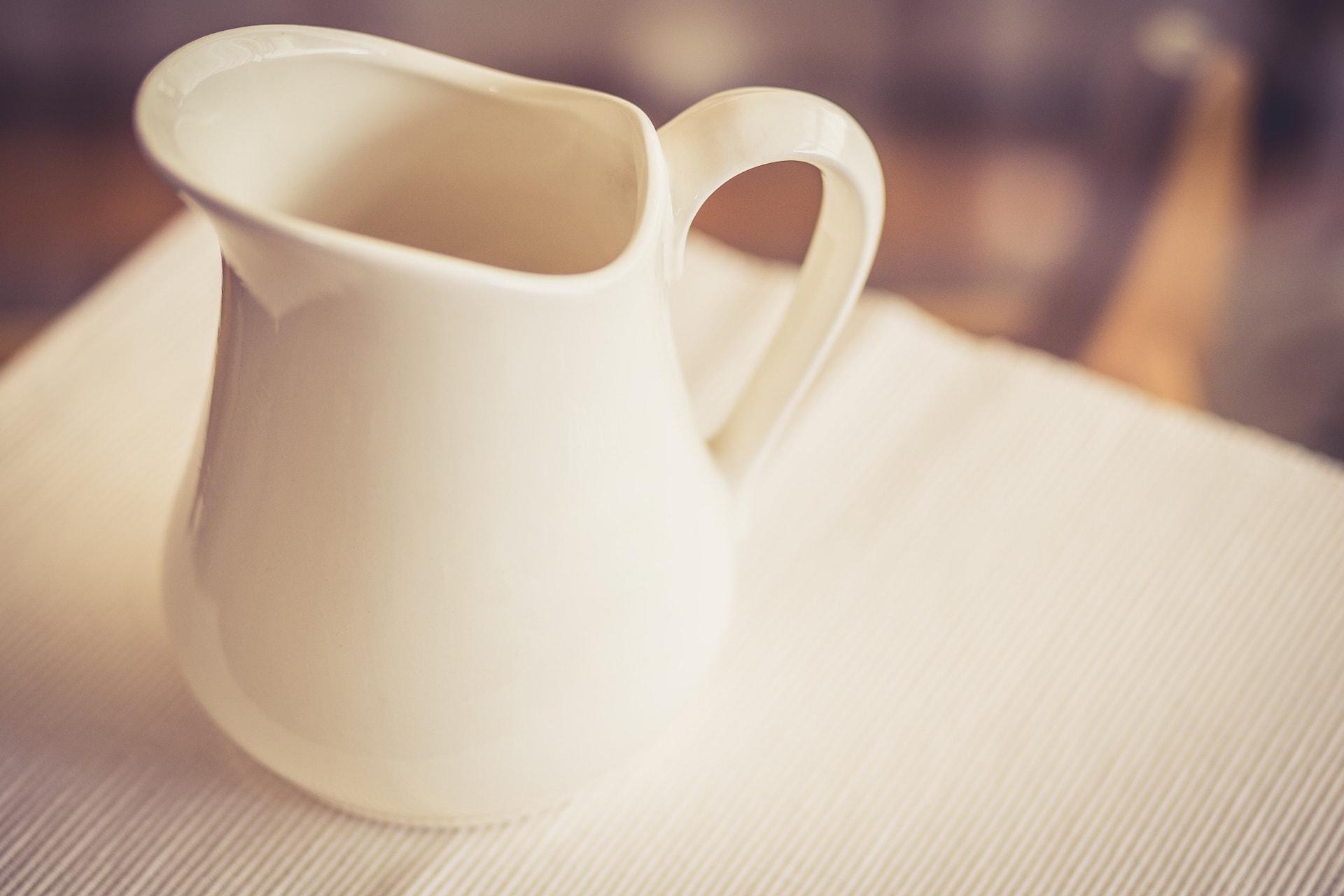 Milk Jug on a Glass Table - Warm Tone