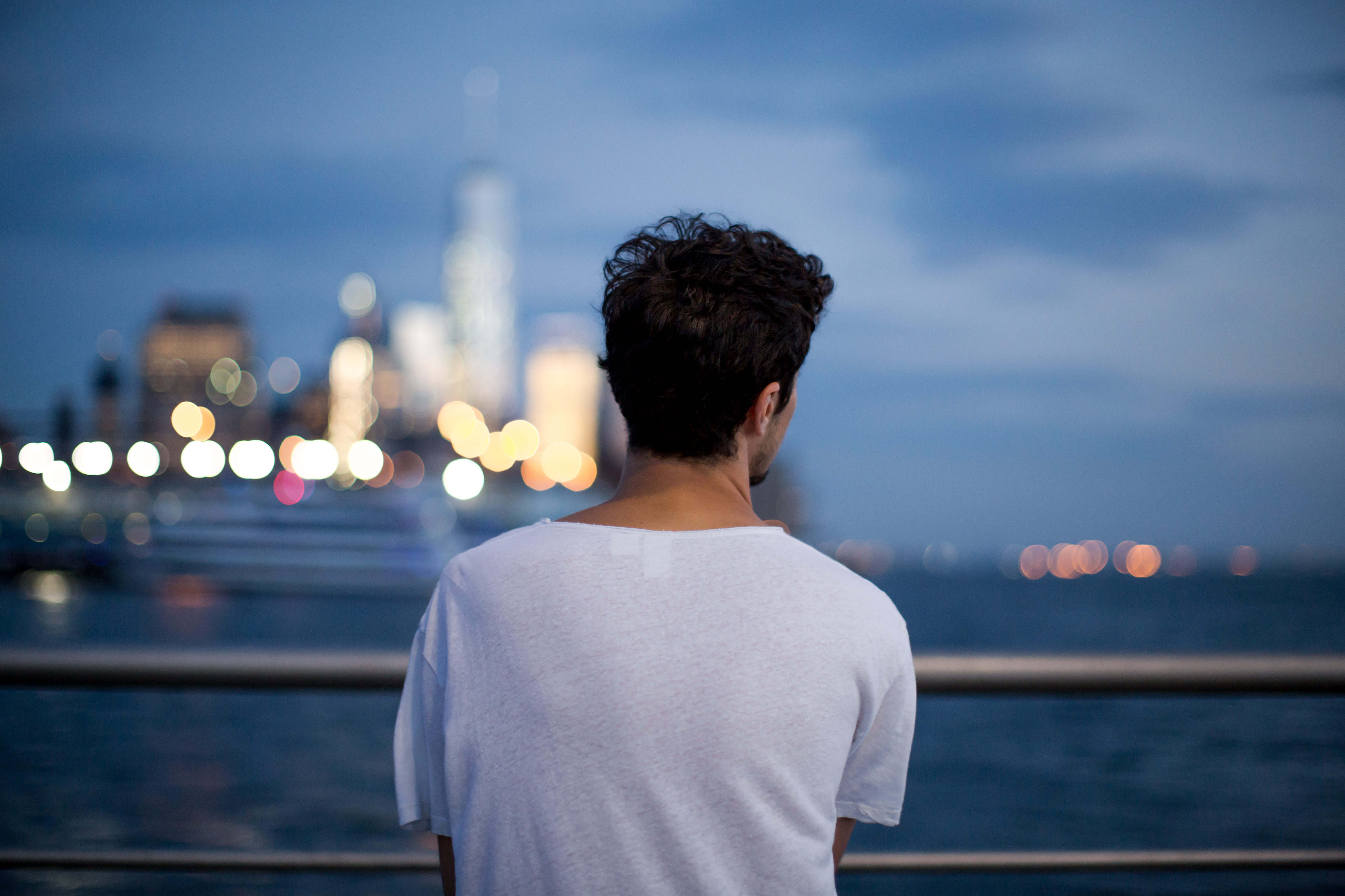 Man looking in to night city example image 1