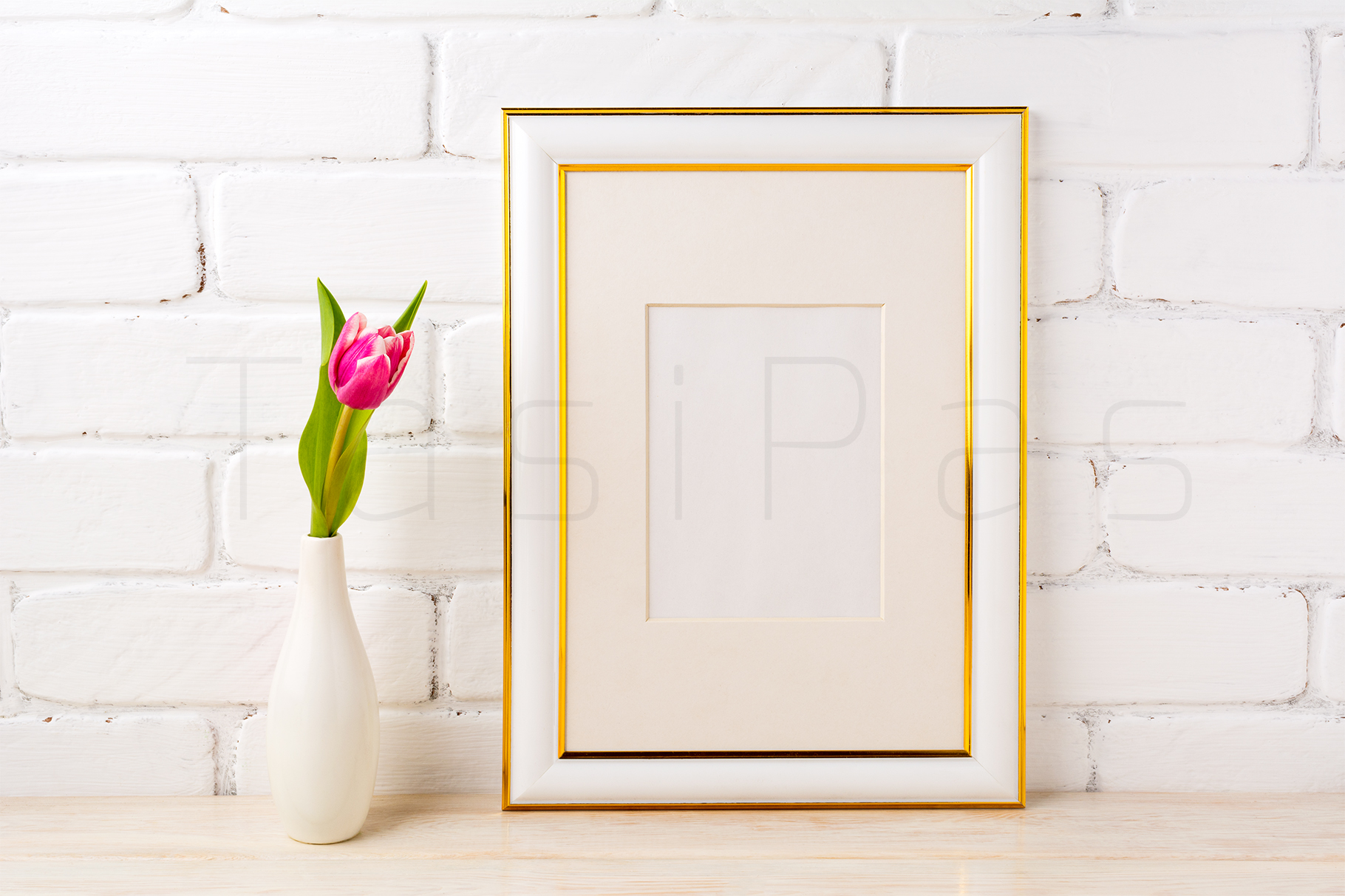 Gold decorated frame mockup with rich magenta pink tulip in elegant vase near white painted brick wall. example image 2