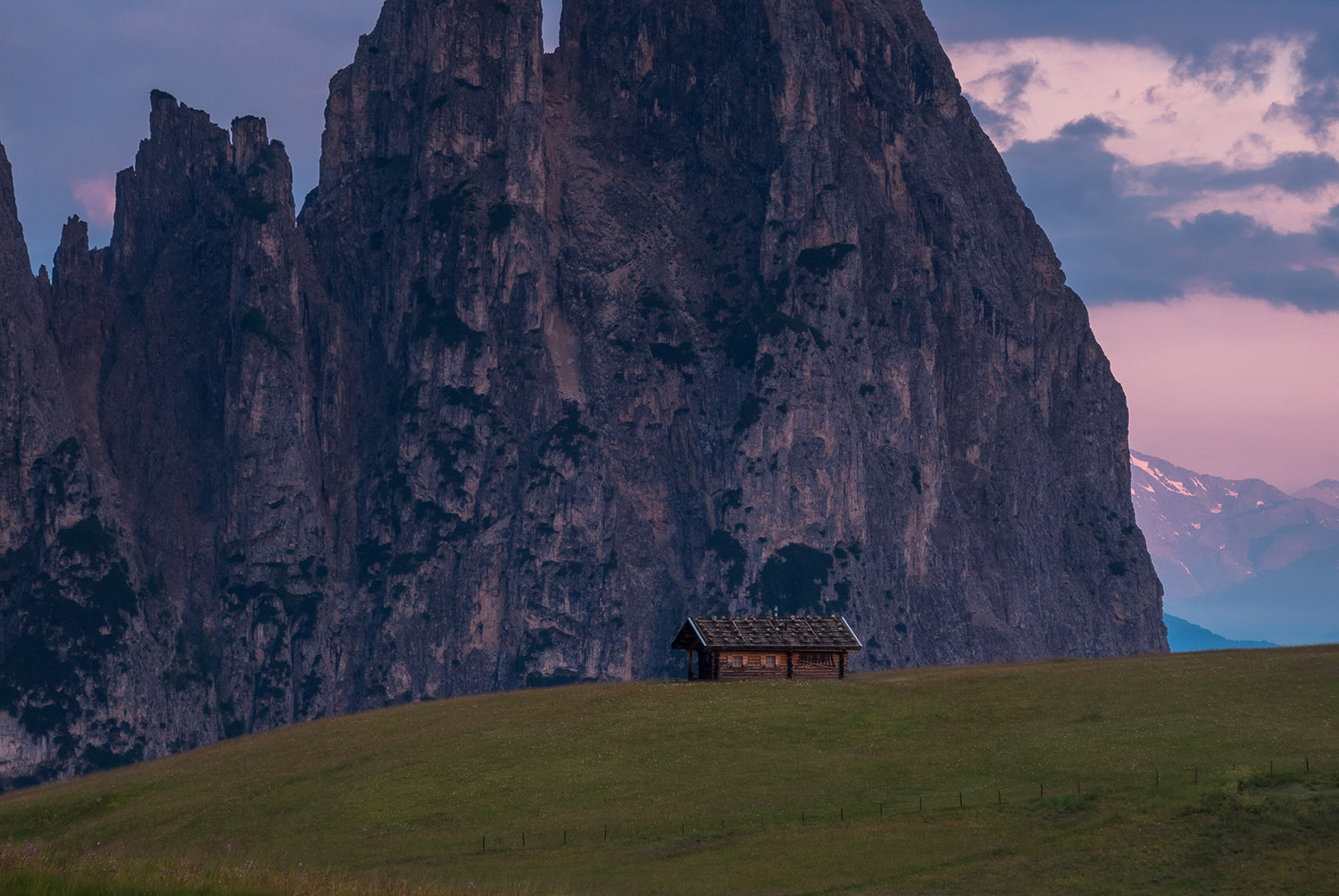 Cottages at Alpe di Siusi at sunrise in the Dolomites example image 1