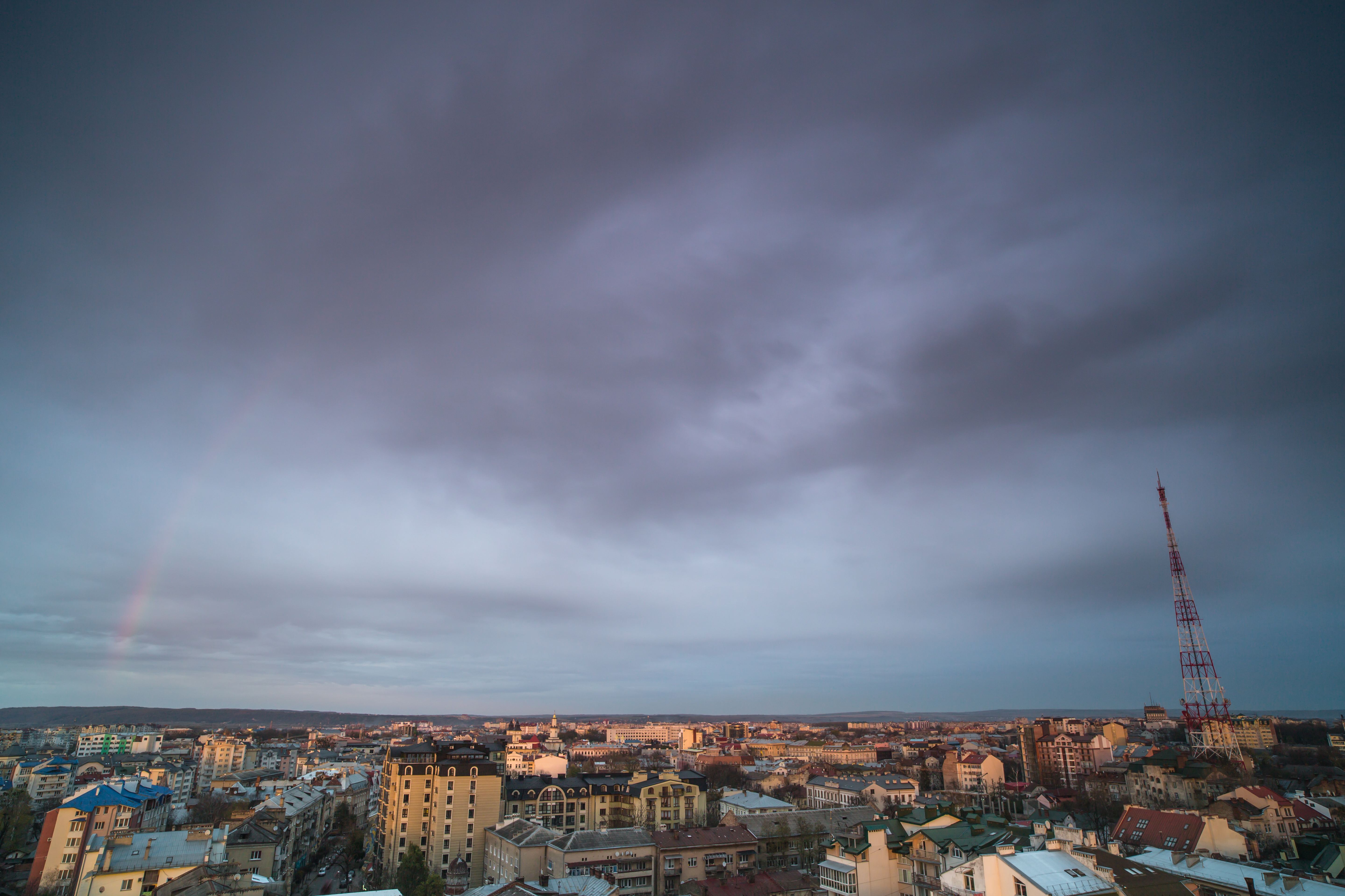 Sunset with rainbow view in a european city example image 1