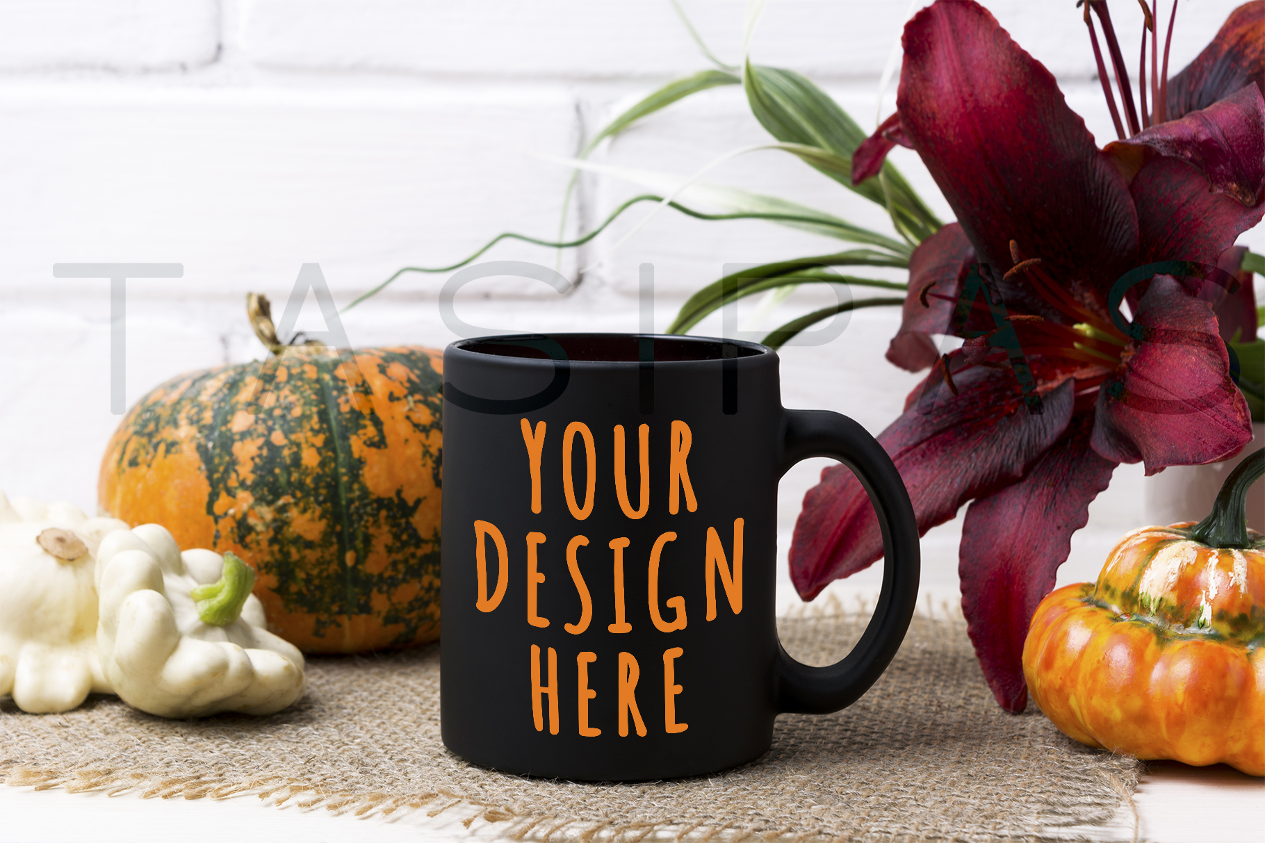 Black coffee mug mockup with pumpkin and red lily. example image 1