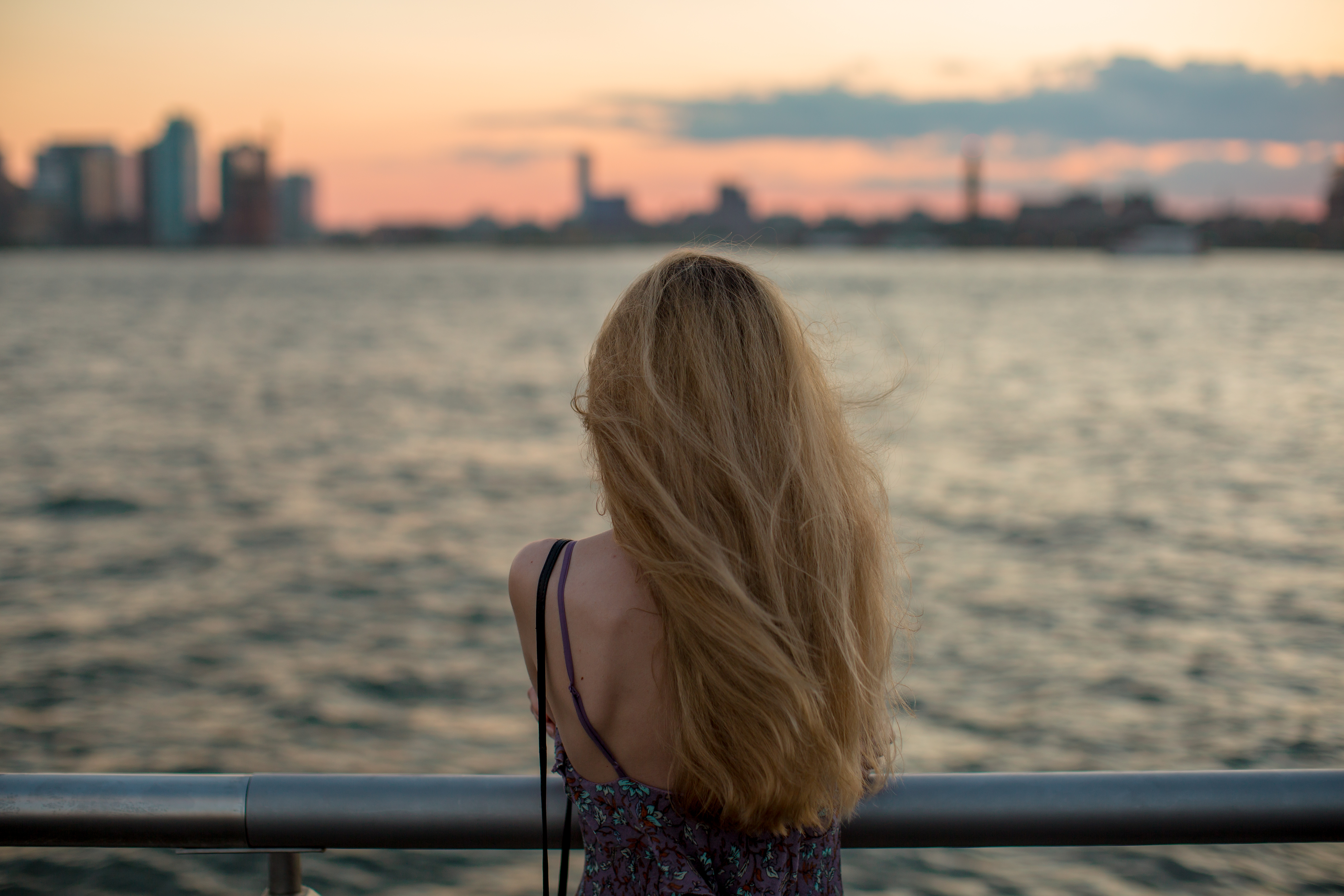 Girl enjoys sunset at the pier example image 1