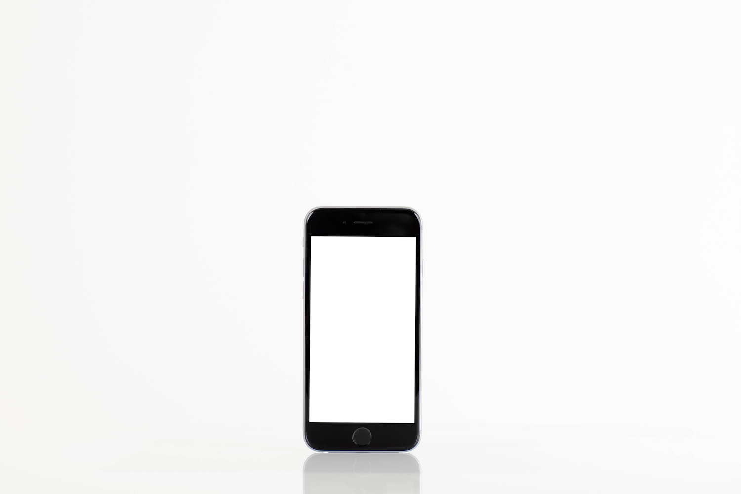 Standing mobile smart phone with blank screen on white background example image 1