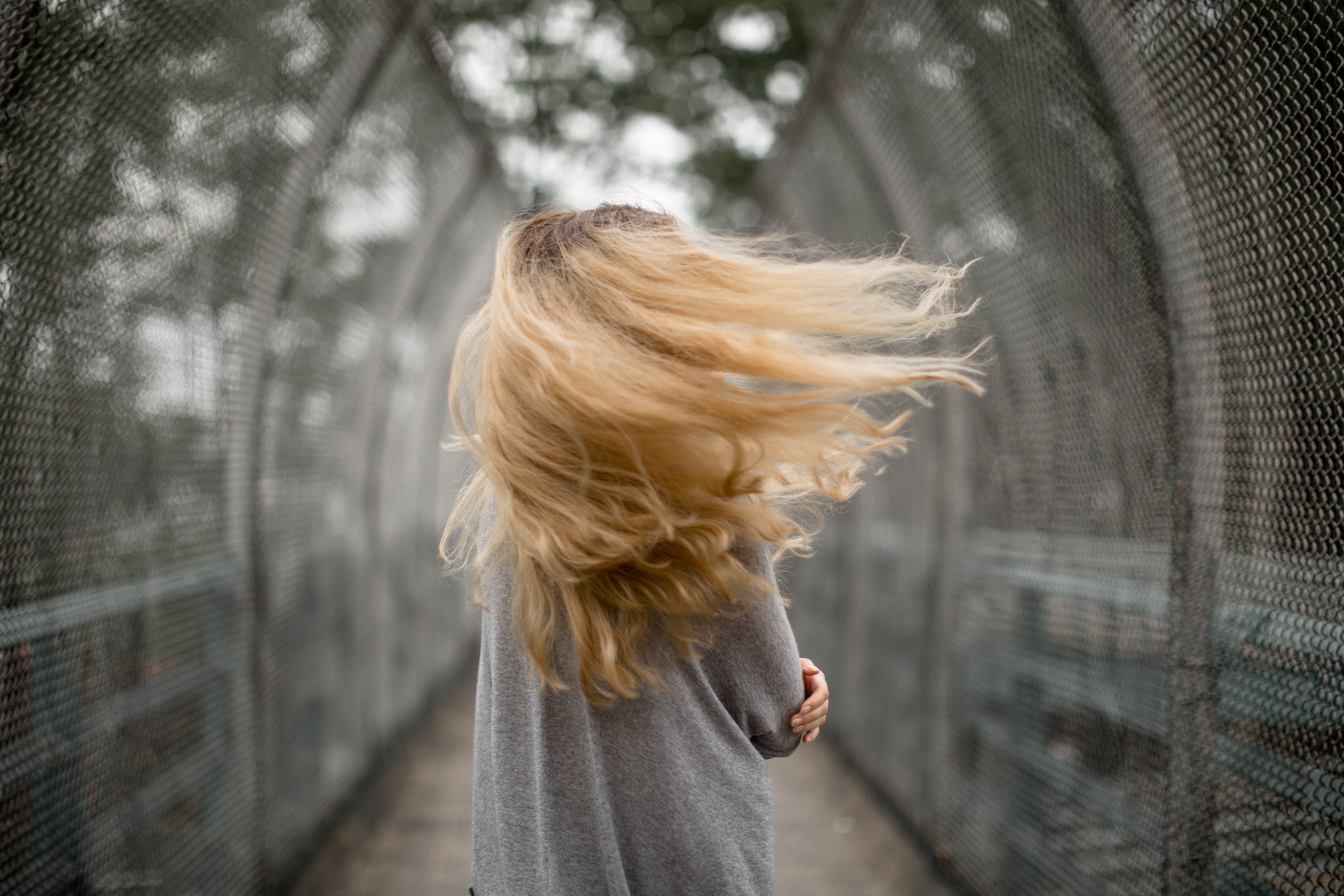 Girl on a windy day example image 1
