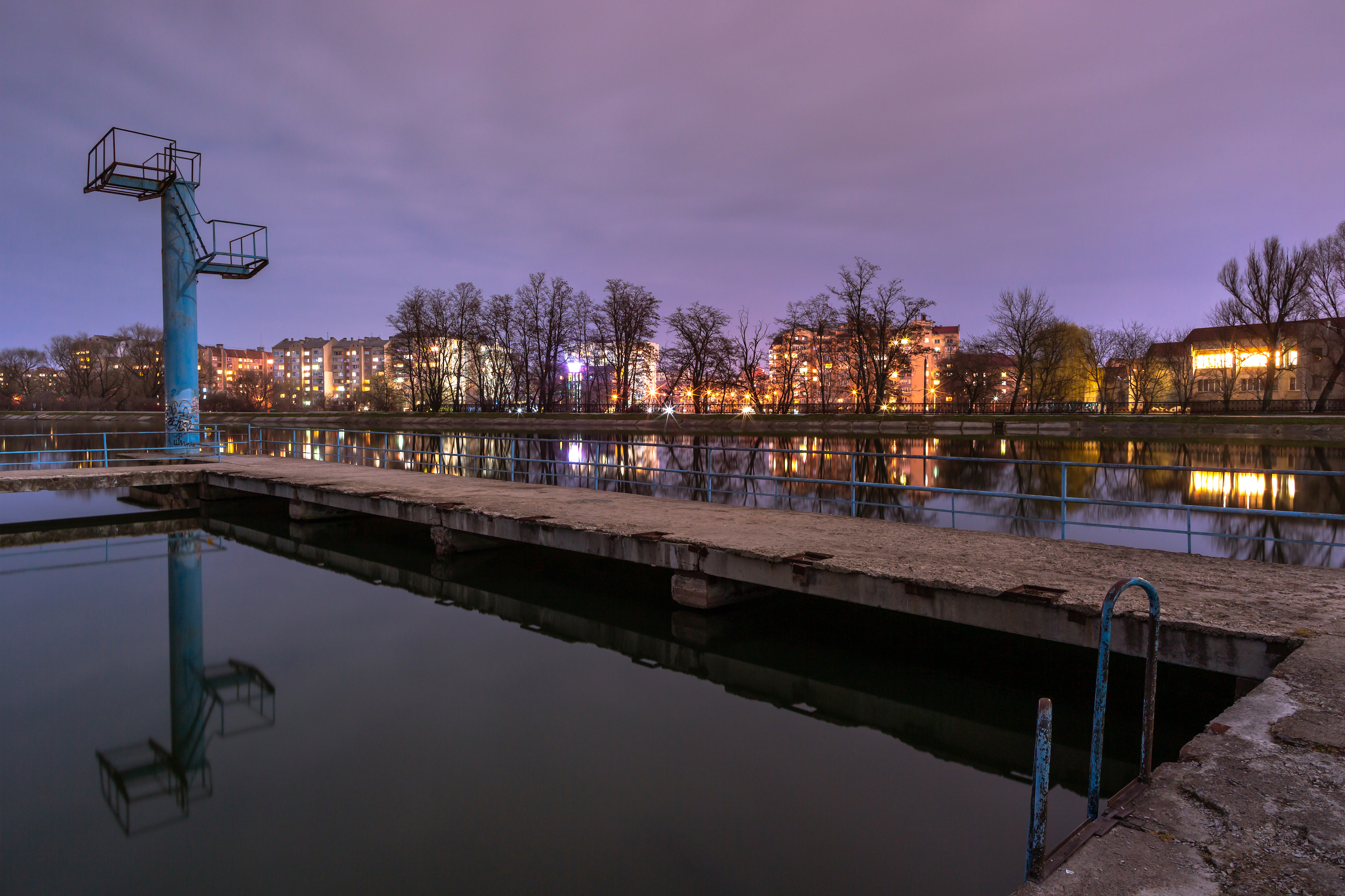 View on the lake with swimming area at night example image 1