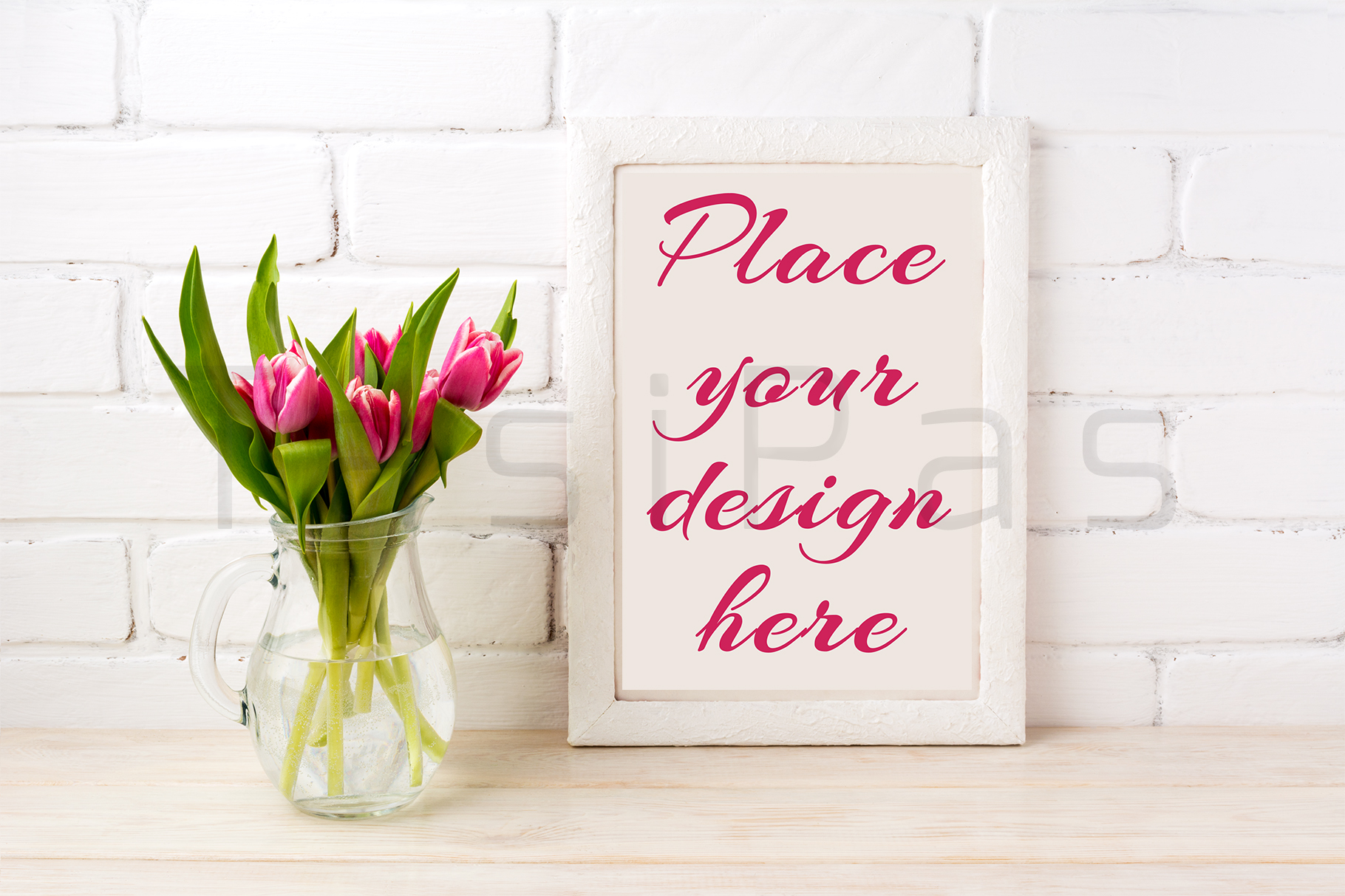 White frame mockup with magenta pink tulips bouquet in glass jug near white painted brick wall.  example image 3