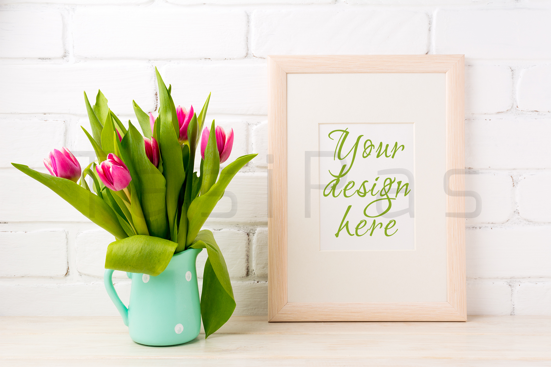 Wooden frame mockup with bright pink tulips bouquet in mint jug near white painted brick wall.  example image 1