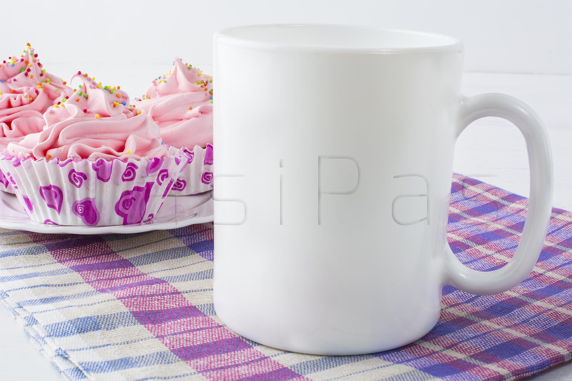 Coffee mug mockup with checkered napkin example image 2