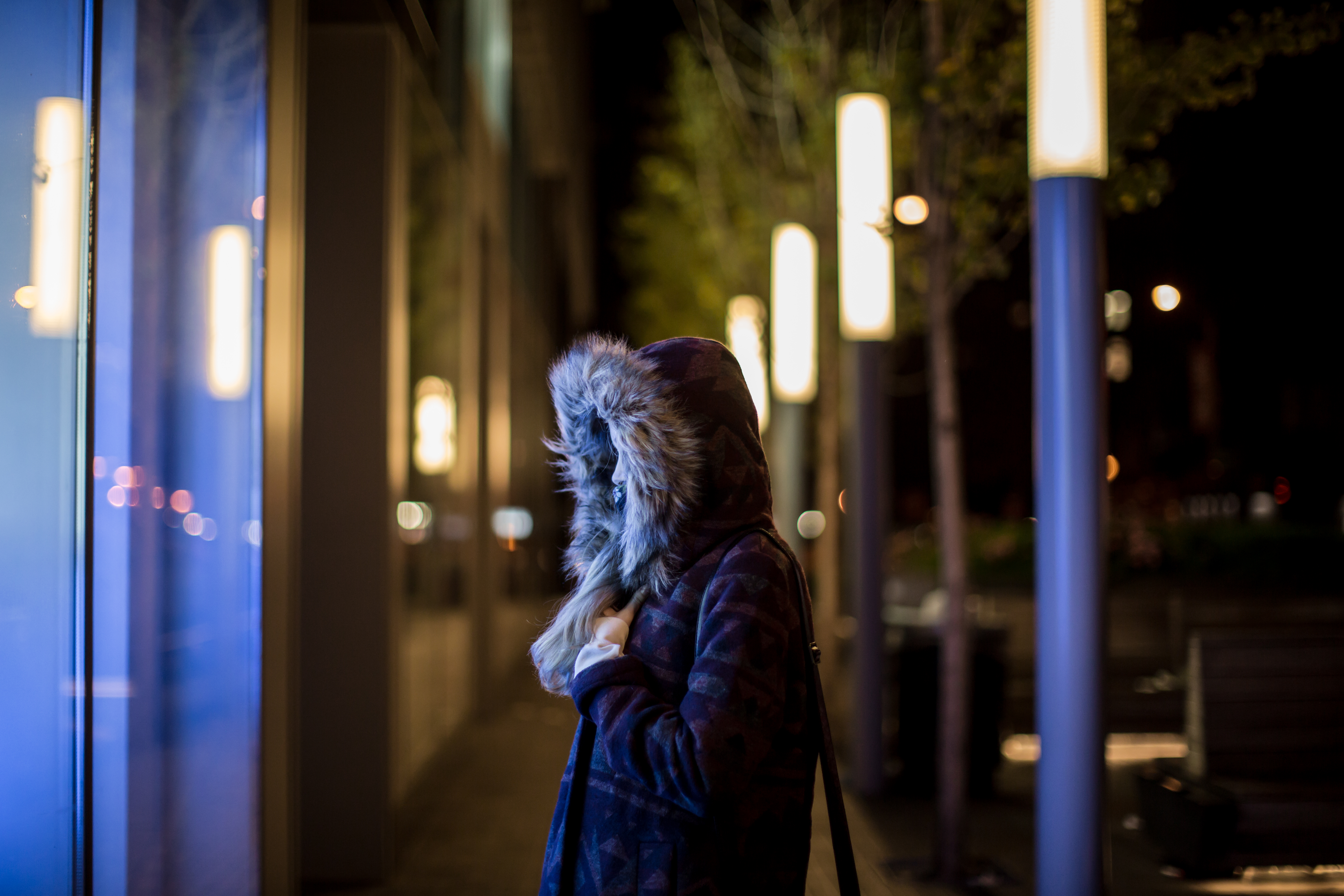 Girl on a cold night in city example image 1