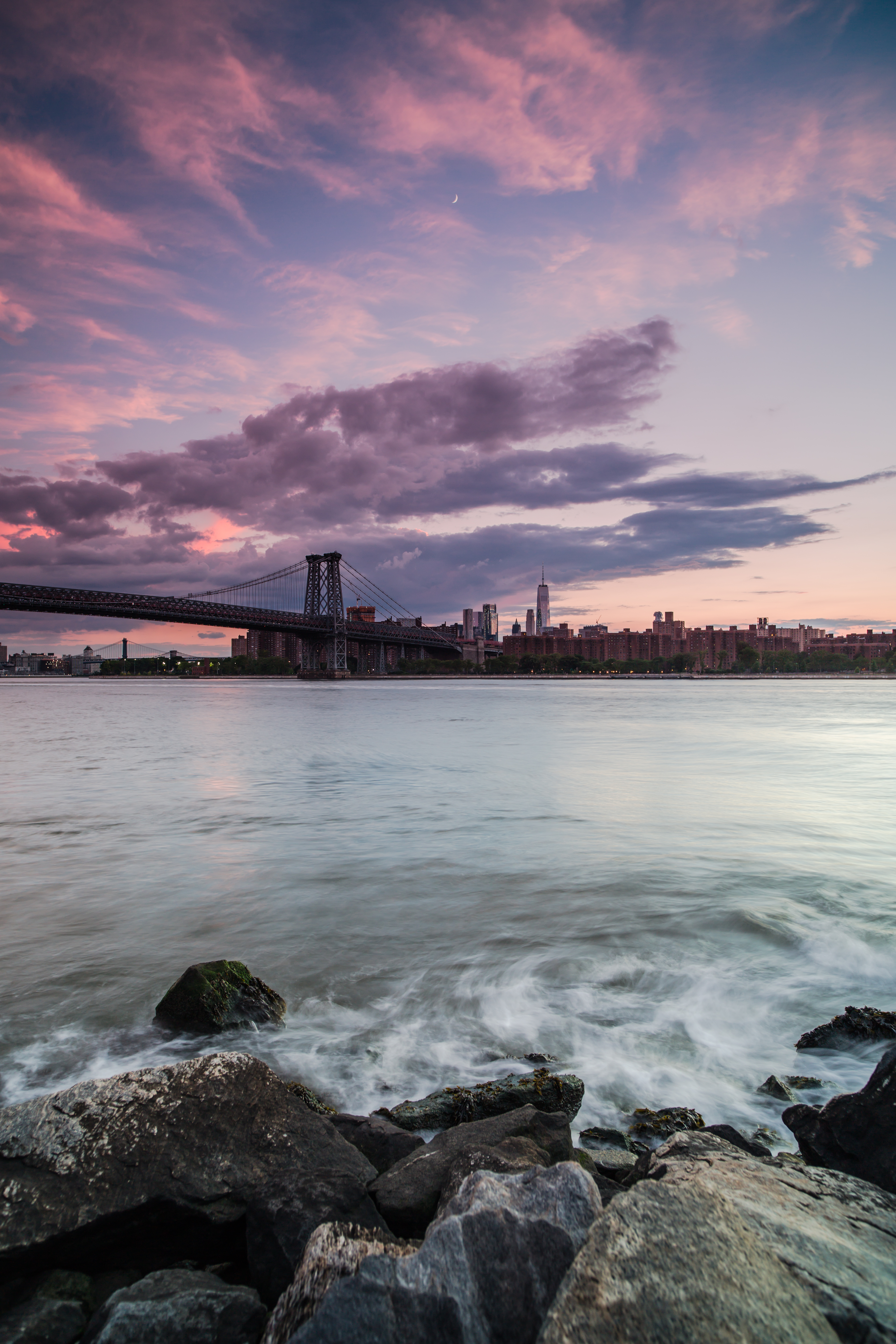 Sunset view on Downtown Manhattan from the rocks	 example image 1