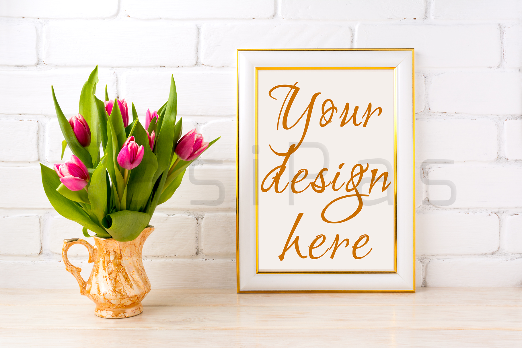 Gold decorated frame mockup with bright pink tulips bouquet in gold jug near white painted brick wall.  example image 2