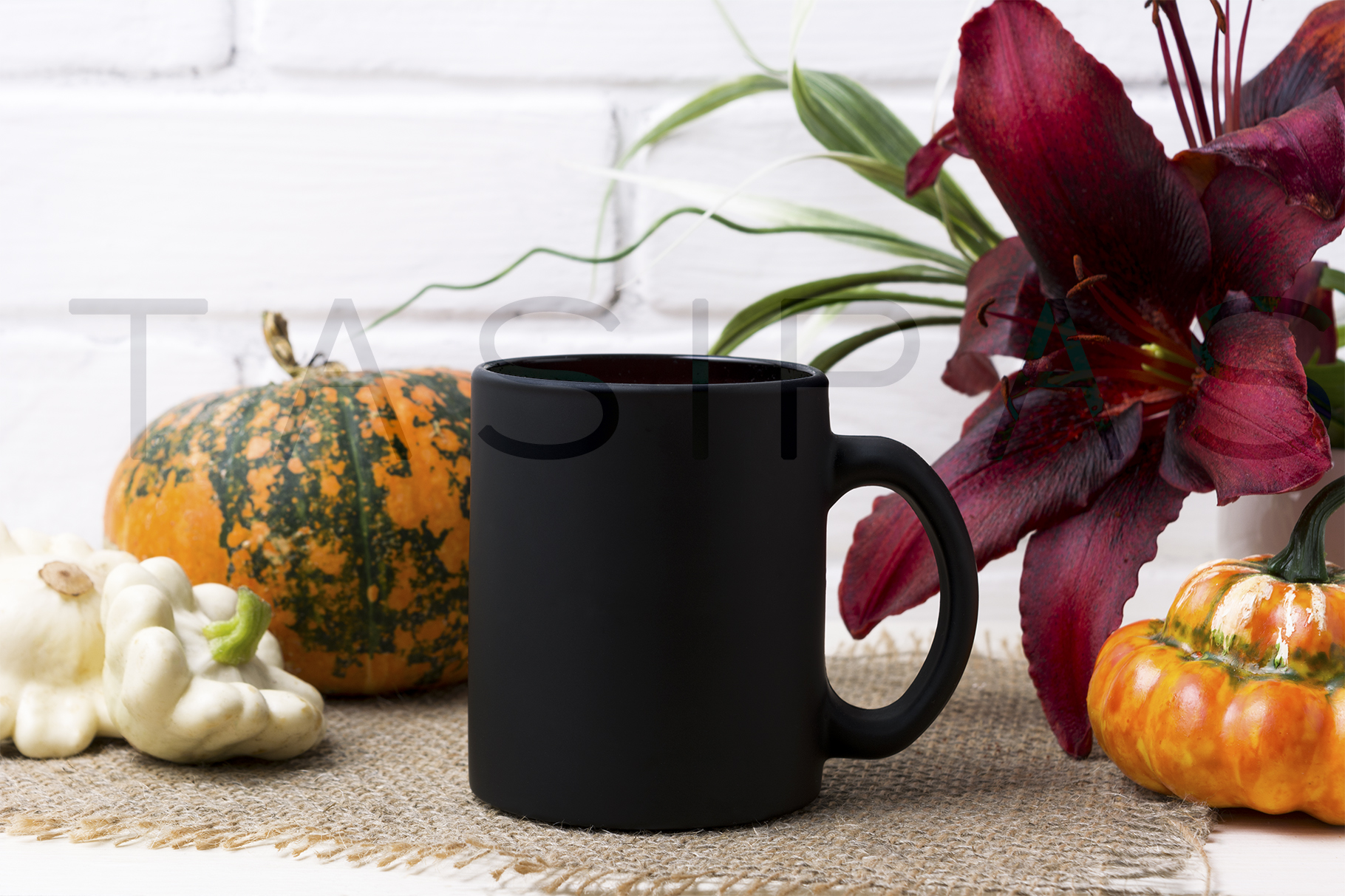 Black coffee mug mockup with pumpkin and red lily. example image 2