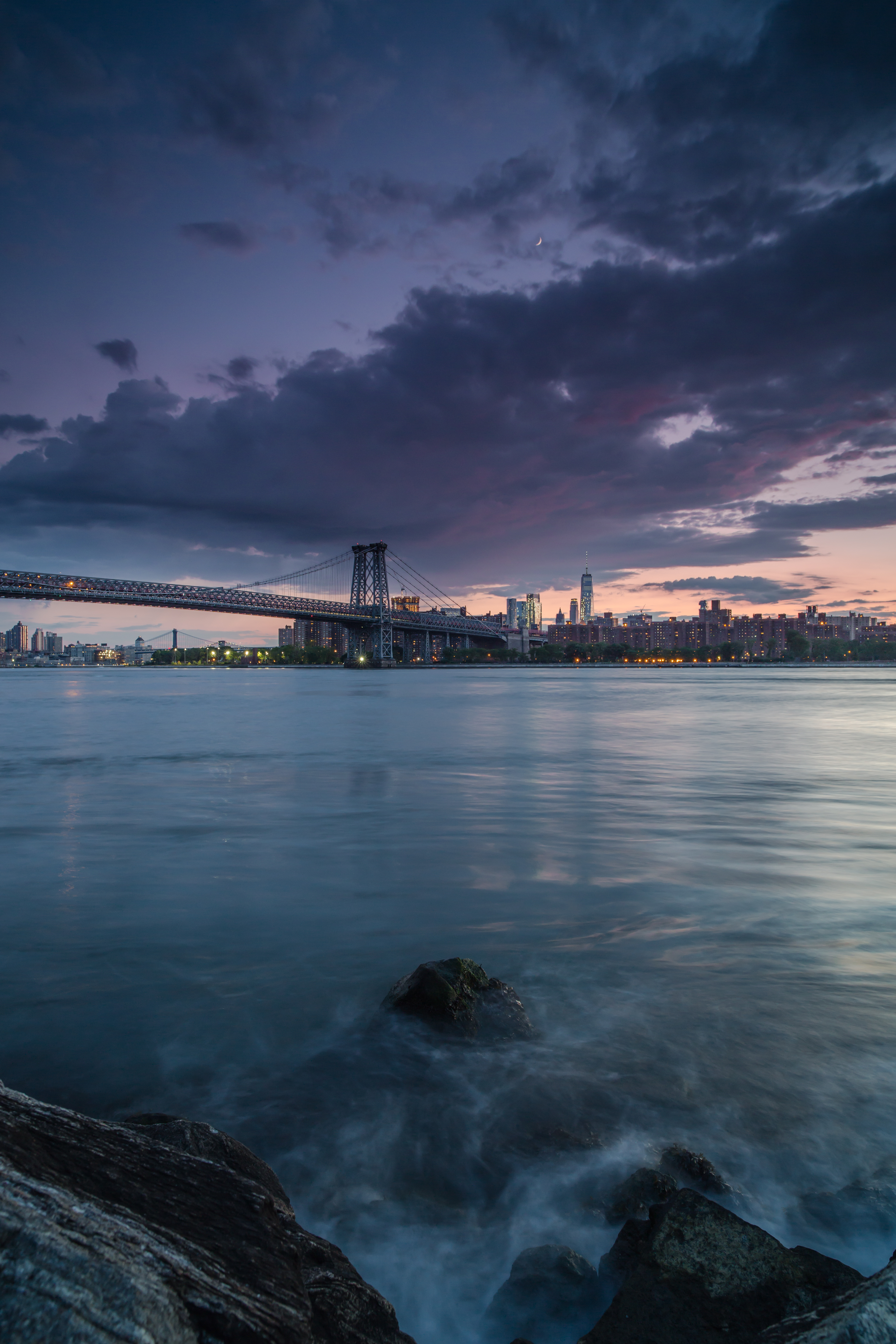 Sunset view on Manhattan from the rock beach example image 1