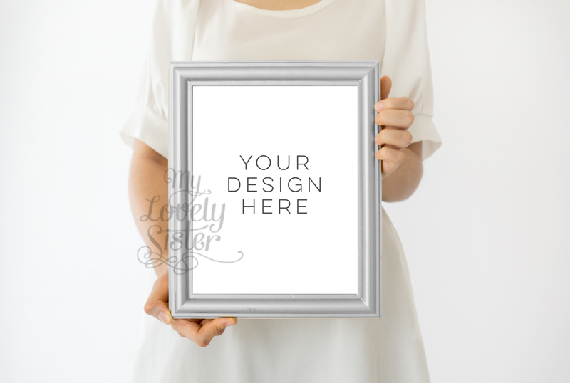 Silver Frame, Girl holding print Wall art Mockup, Minimalist Product Mockup, Girl Holding Frame, Photoshop Mock Up, Styled stock photography example image 1