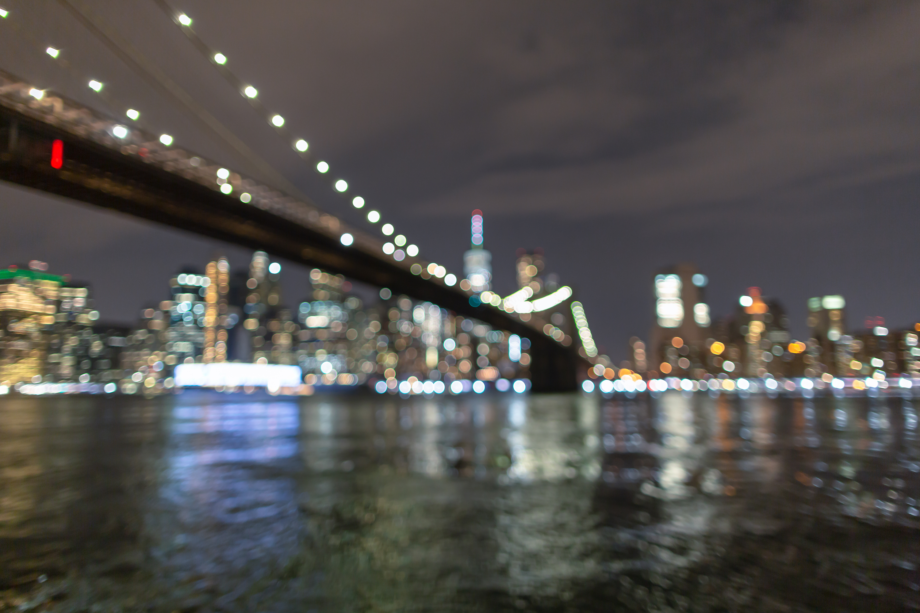 Blurred Financial District at night from East River example image 1
