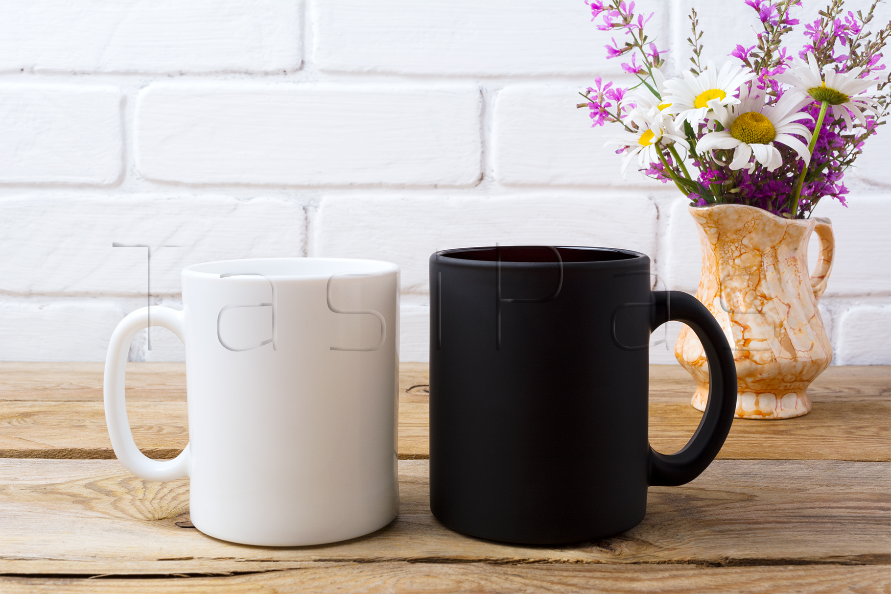 White and black coffee mug mockup with white chamomile and purple field flowers in golden pitcher vase. example image 2