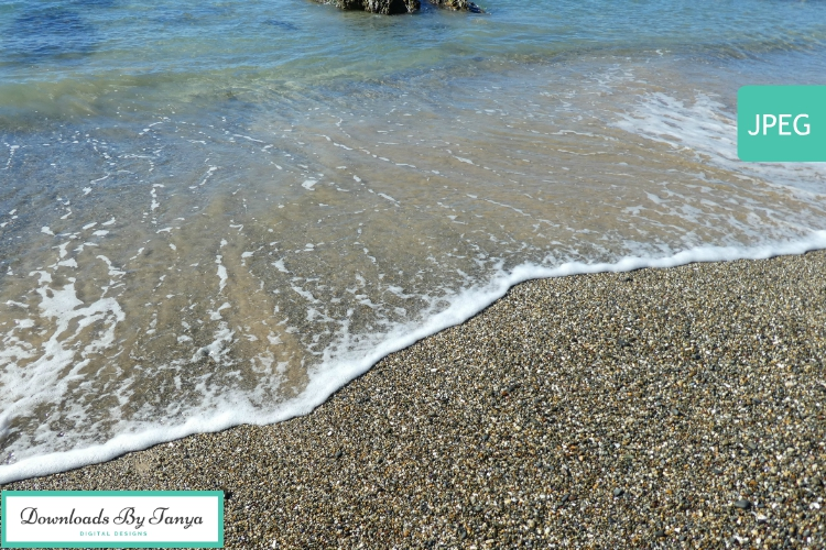 Waves lapping a pebble beach photo example image 2