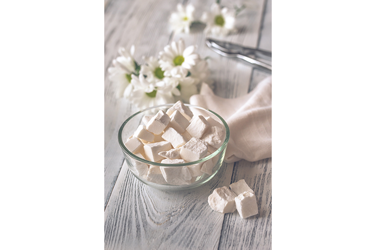 Bowl of white lump sugar example image 1