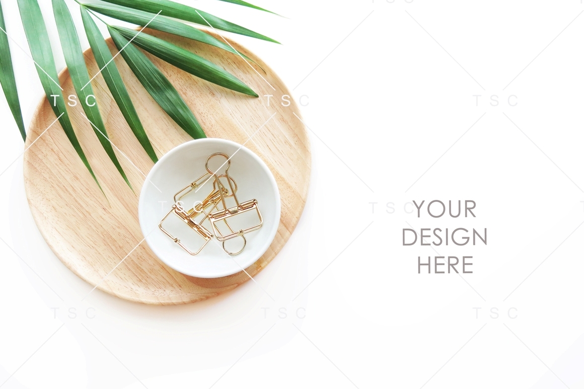 Paper Clips, Wooden Tray and Palm Leaf Stock Photo example image 1