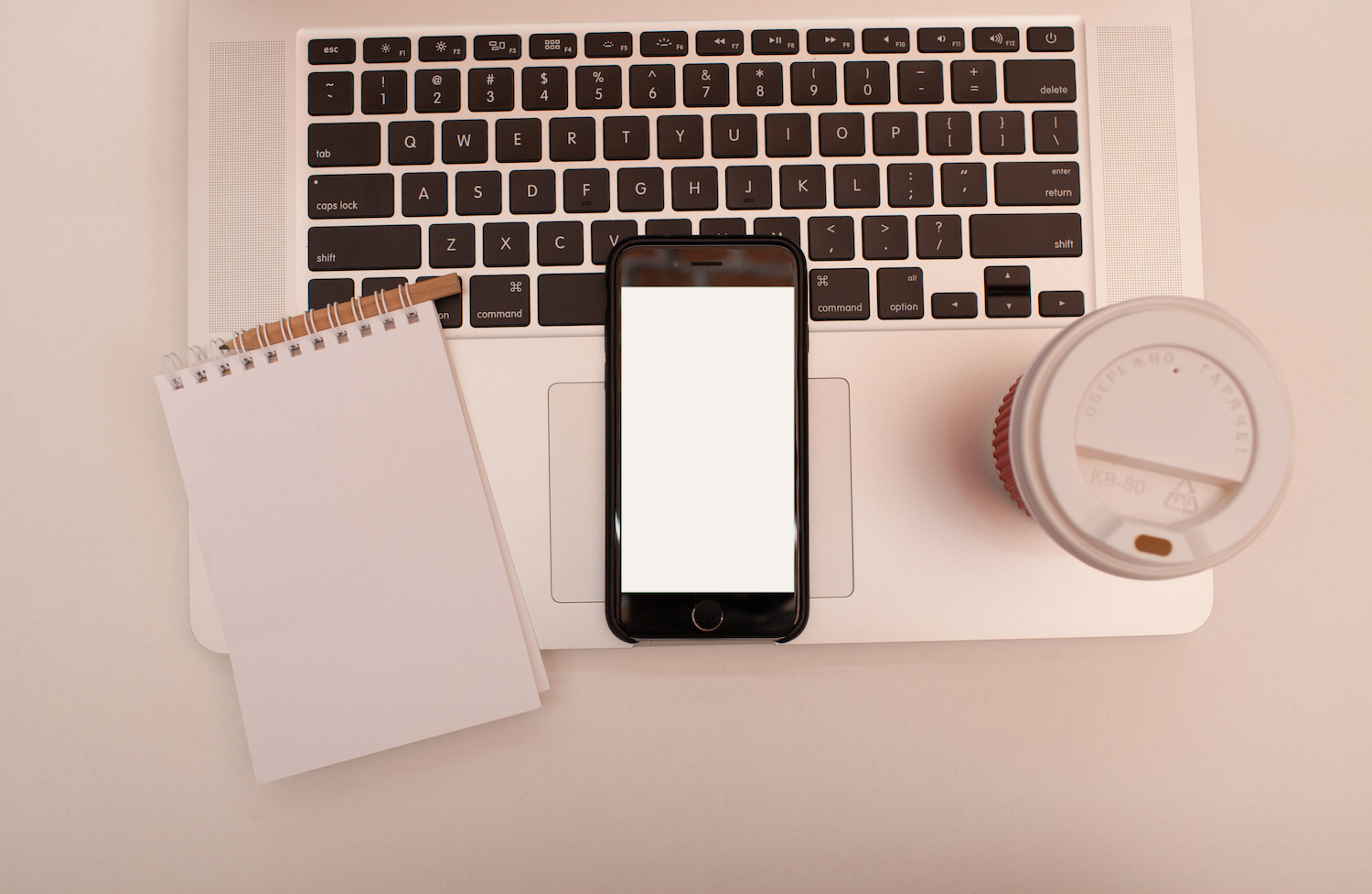 Smartphone with blank screen on the laptop  example image 1