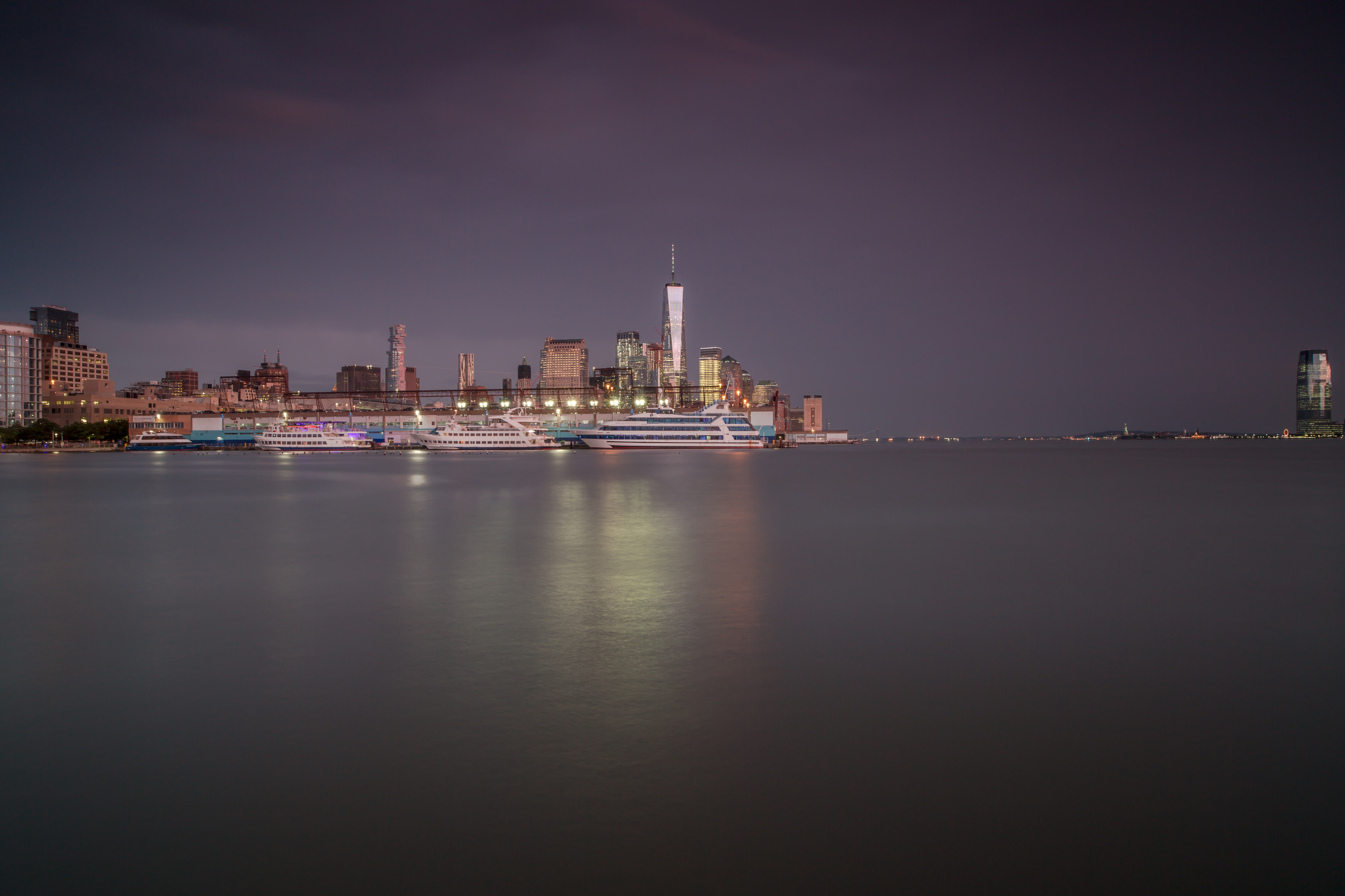 Downtown Manhattan during sunset on a stormy day example image 1