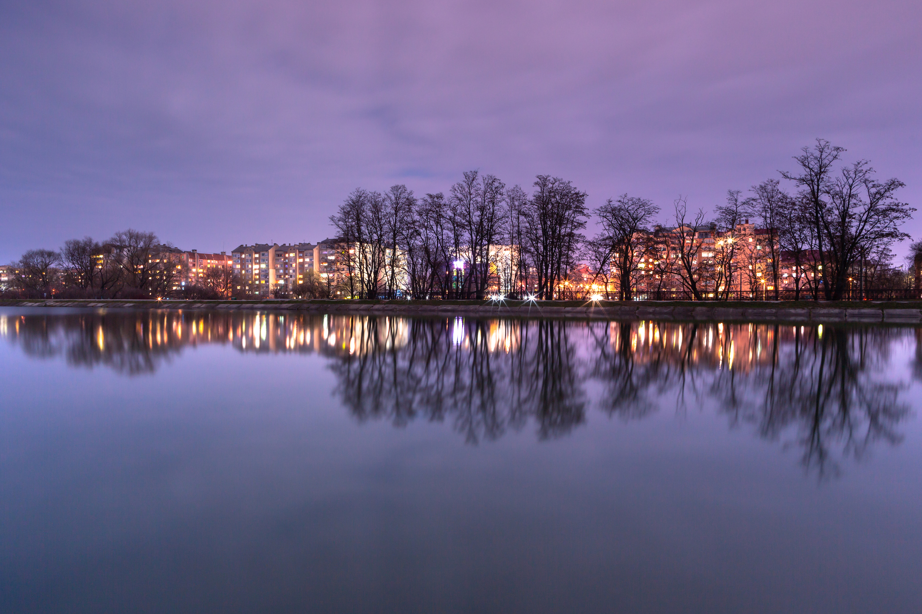 View on Ivano-Frankivsk city from the lake at night example image 1