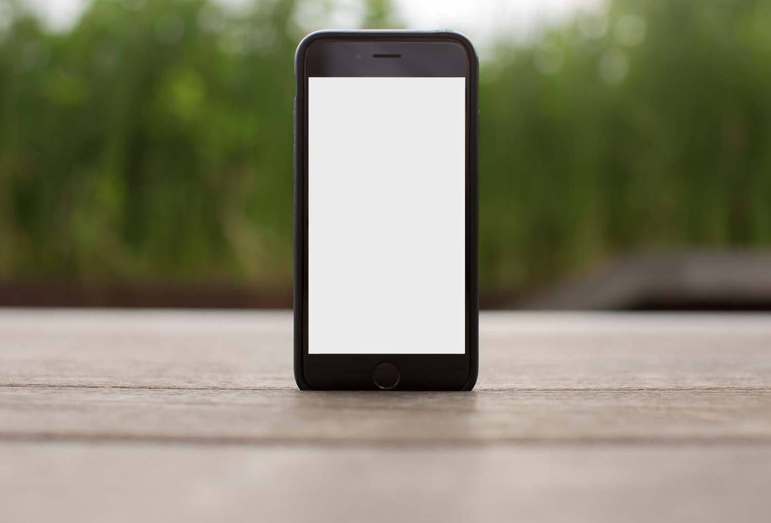 Mobile smart phone with blank screen on the table outdoor example image 1