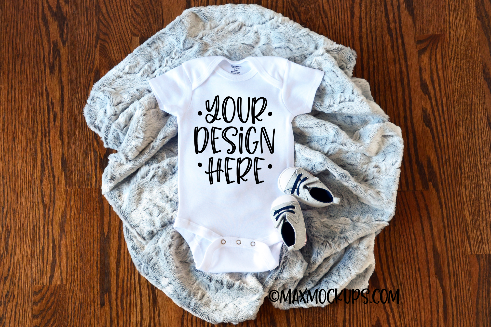White baby bodysuit mockup with grey fur and baby shoes example image 1