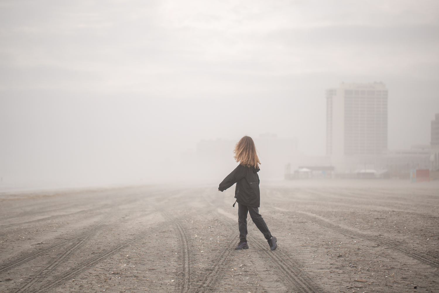 Girl on walking on the beach during fog at atlantic city example image 1