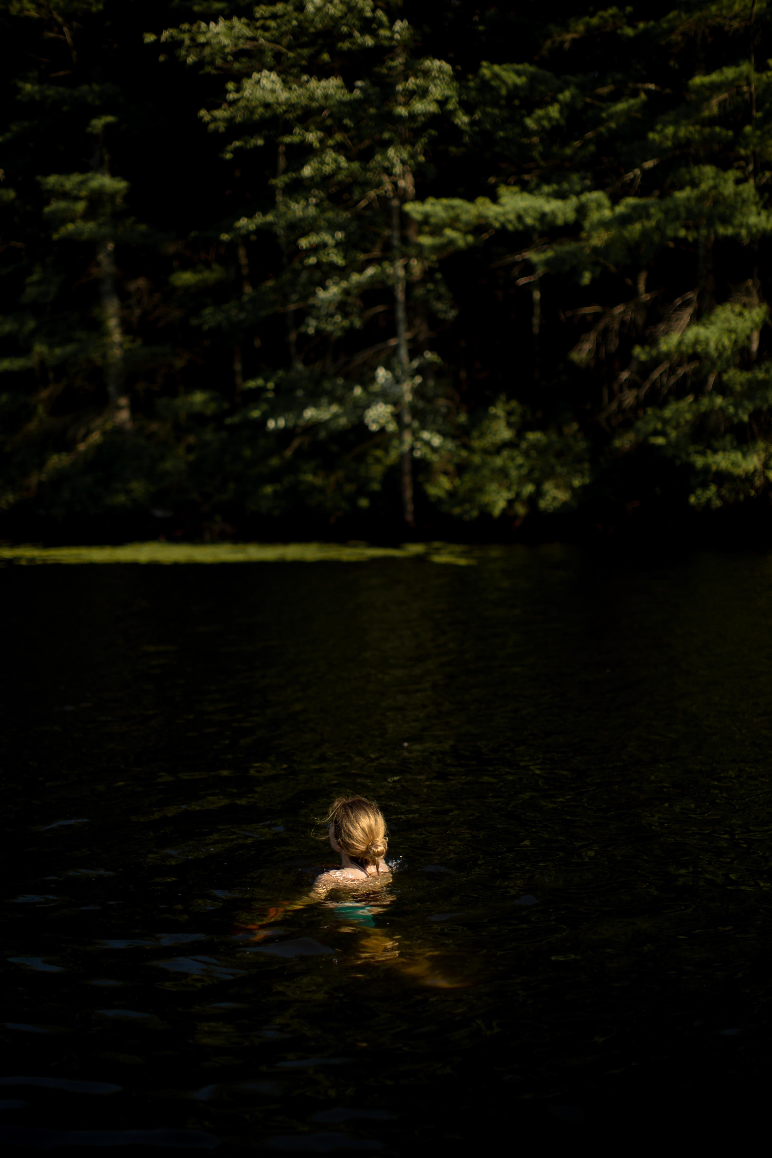 Girl swimming in lake at wood example image 1
