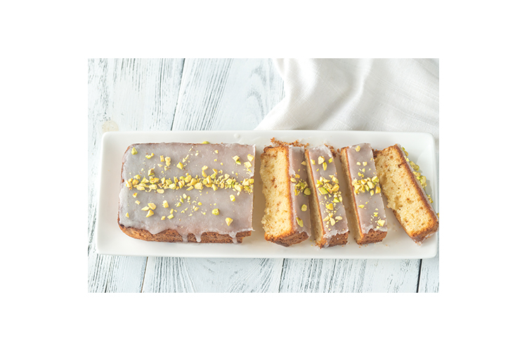 Lemon cake decorated with pistachios example image 1
