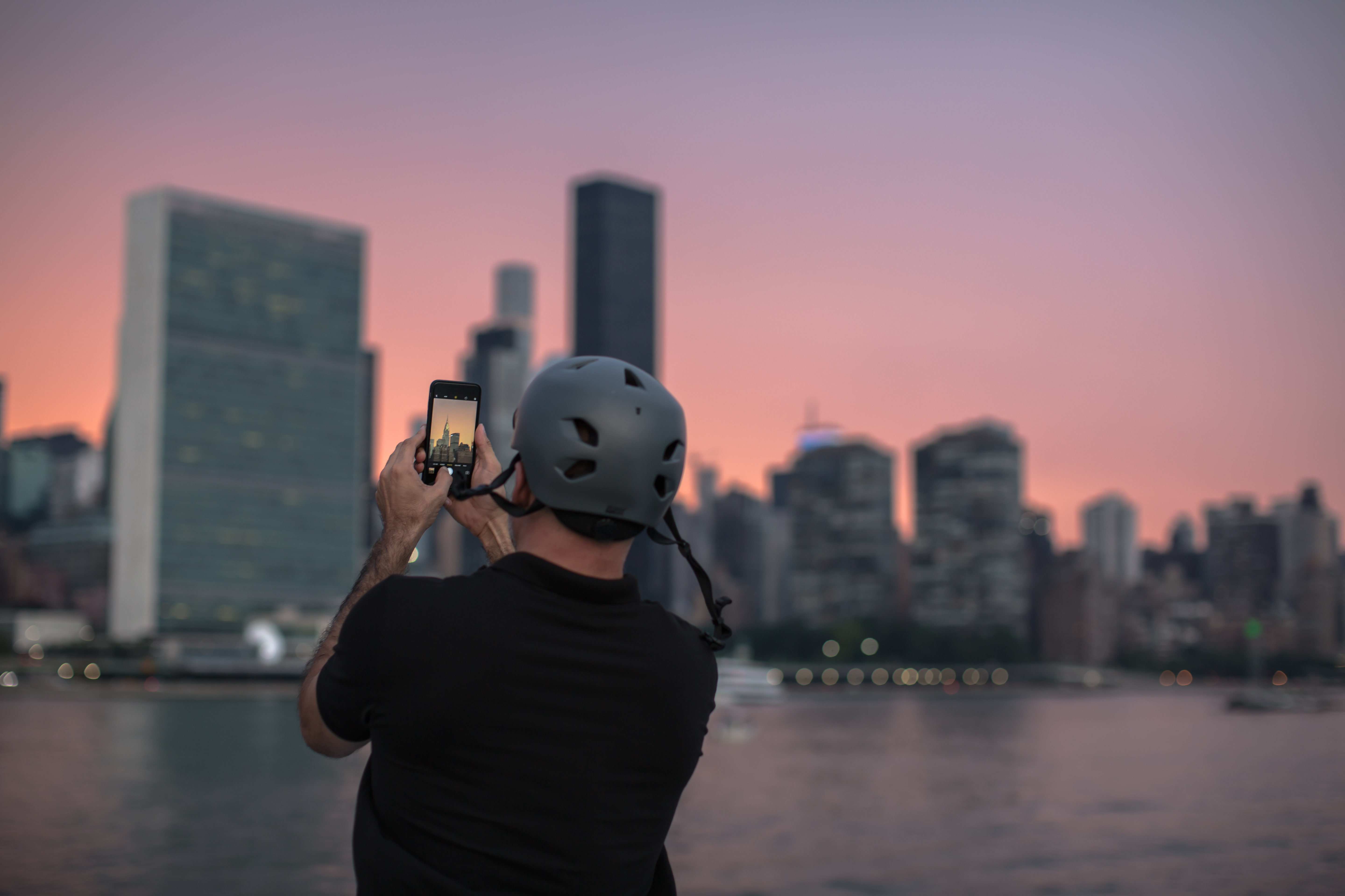Man taking photos during sunset in the city example image 1