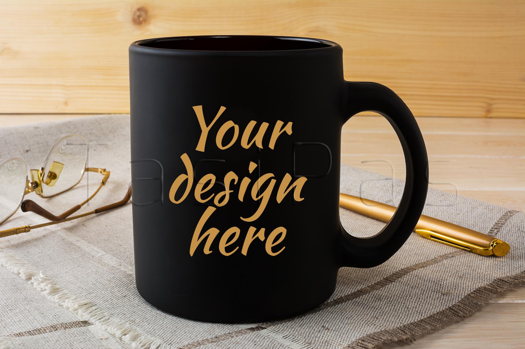 Black coffee mug mockup with glasses and pen example image 1