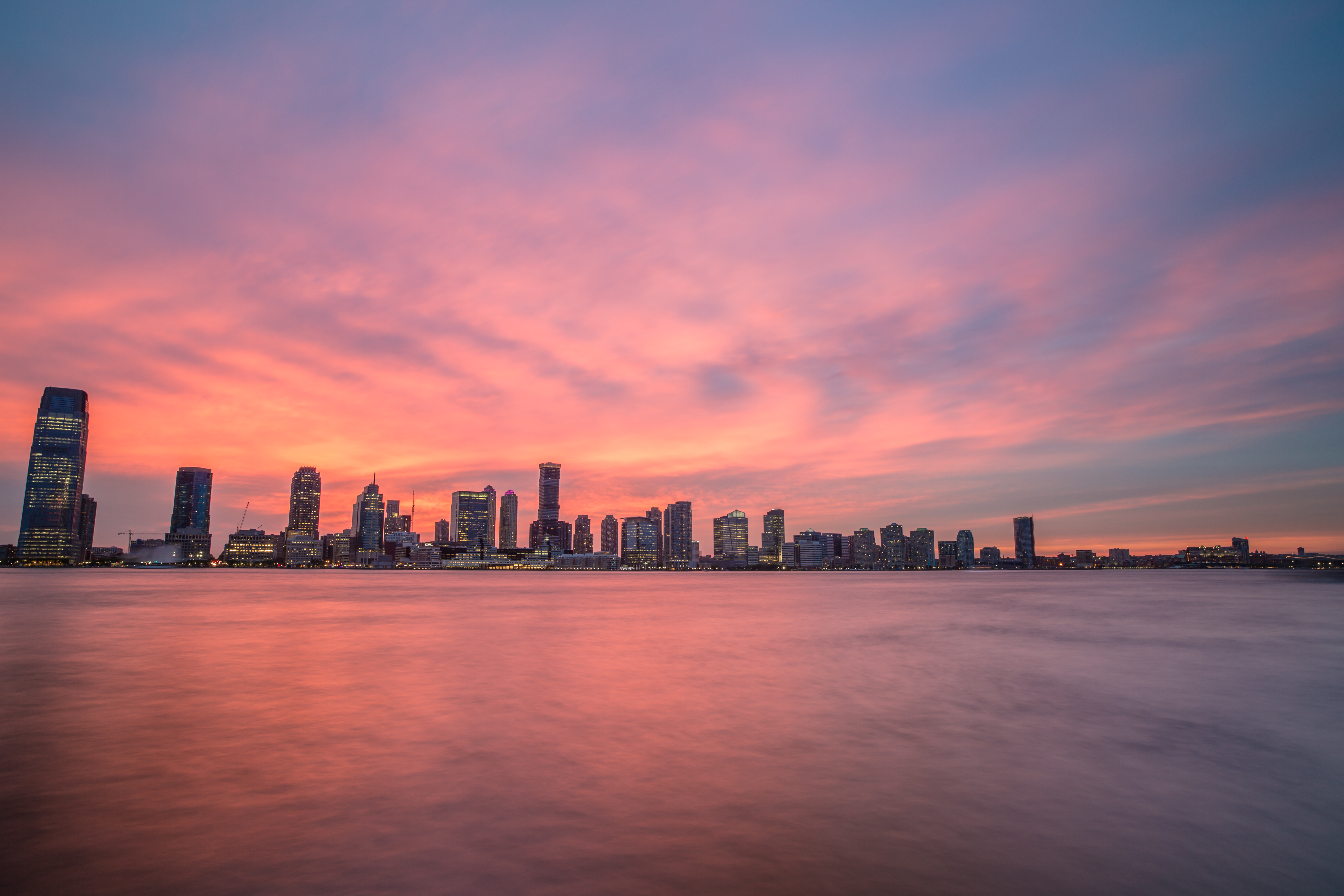 Pink sunset over Jersey city	 example image 1