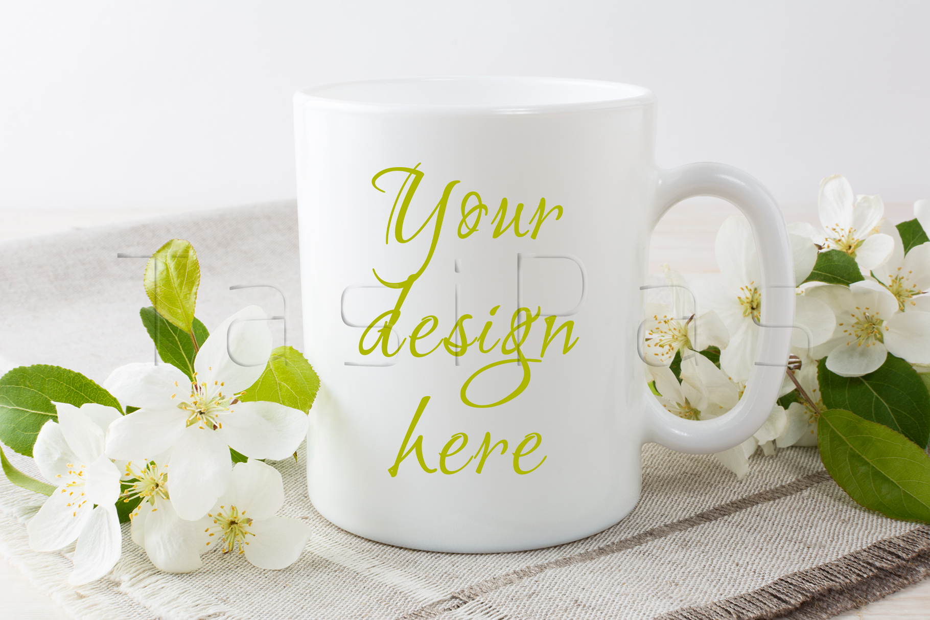 White coffee mug mockup with blossoming apple tree branch. example image 1