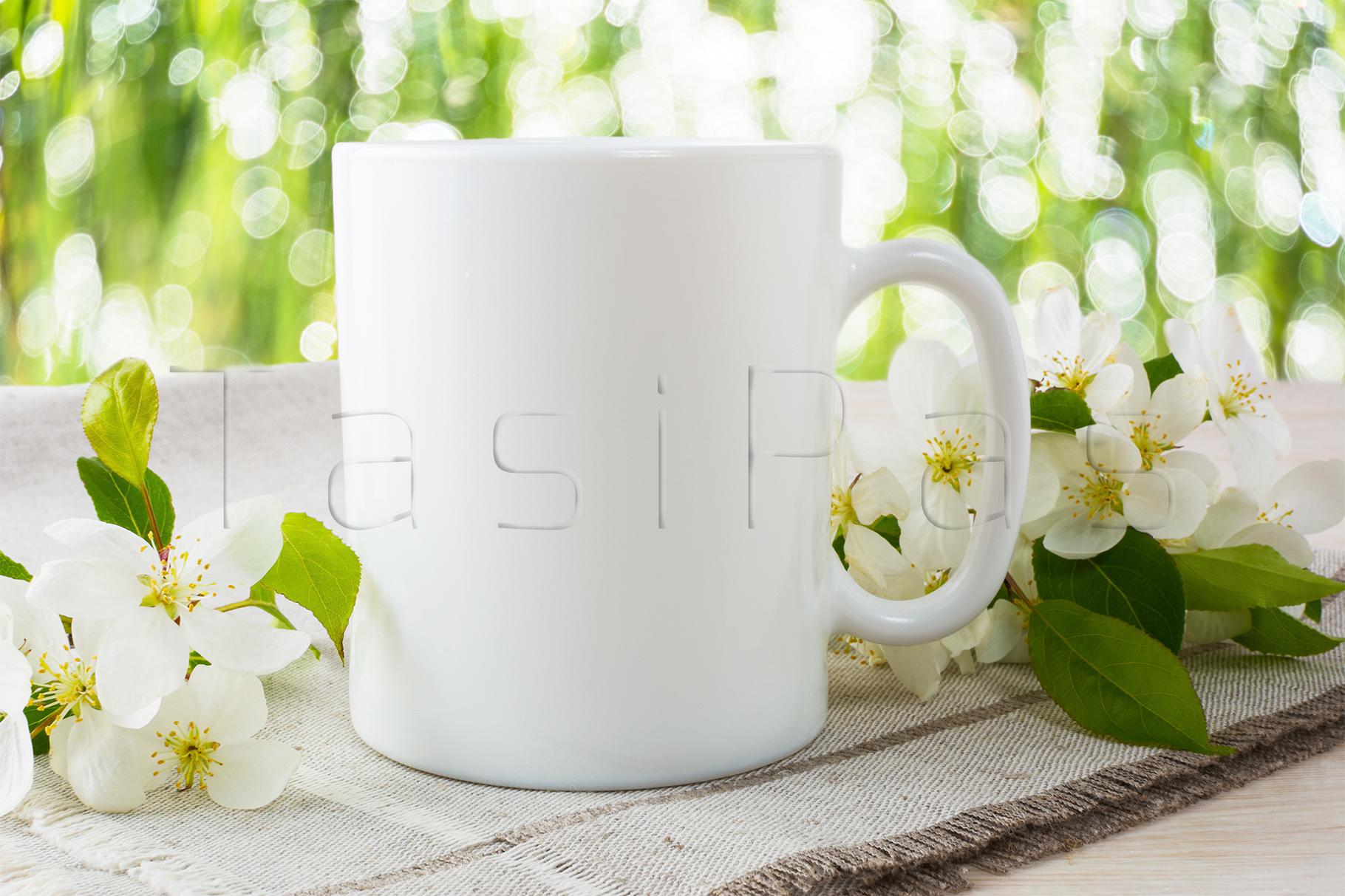 Mug mockup with apple blossom. example image 2