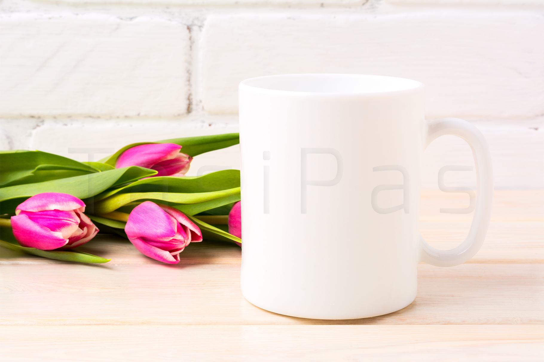 White coffee mug mockup with rich magenta pink tulips bouquet near painted brick wall.  example image 2