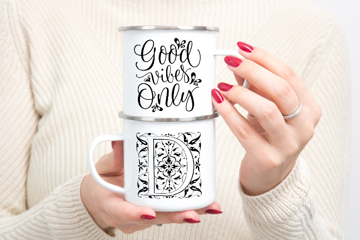 Enamel mug mockup woman holding two Camp sublimation mugs example image 4