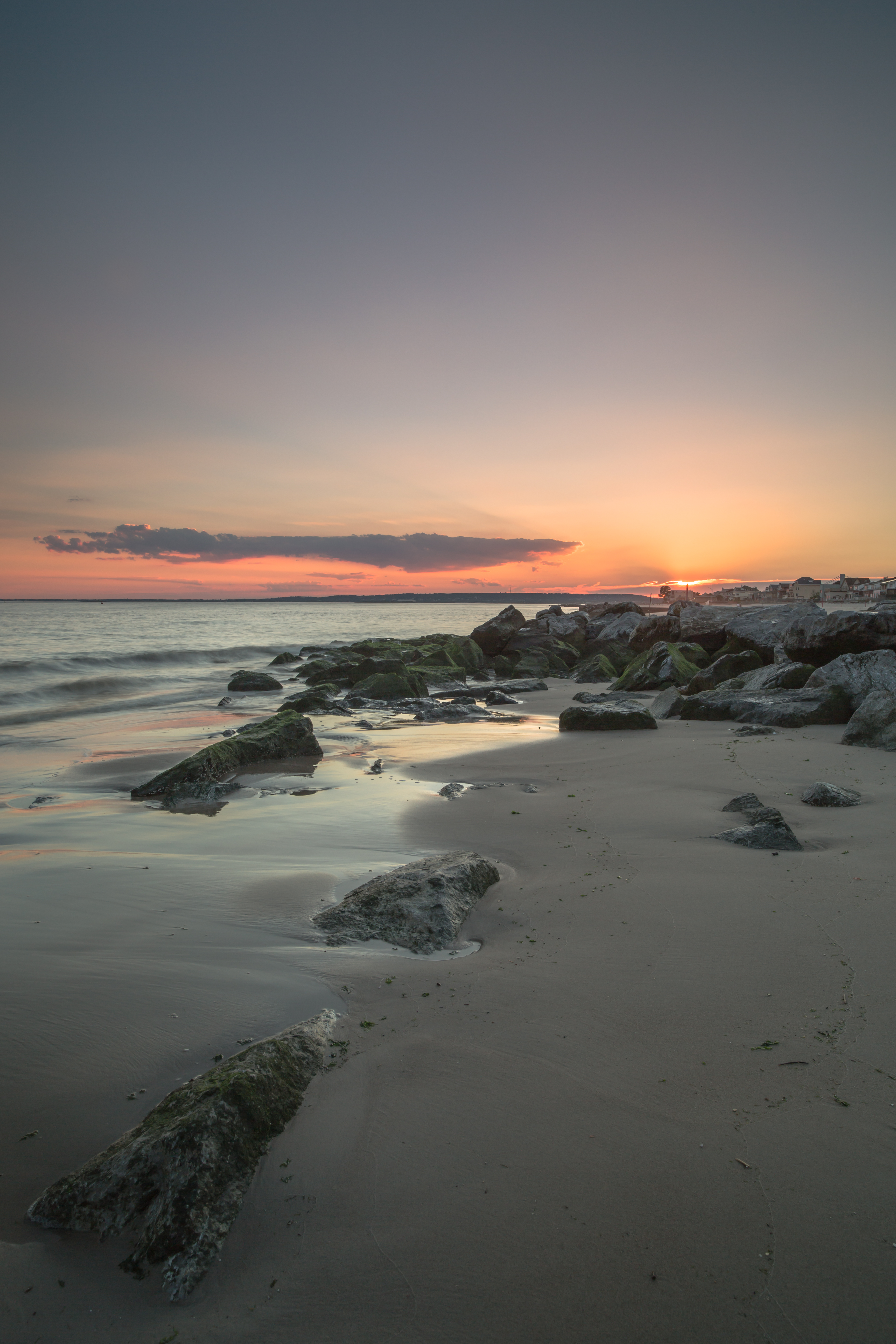 Sunset on the beach with rocks  example image 1