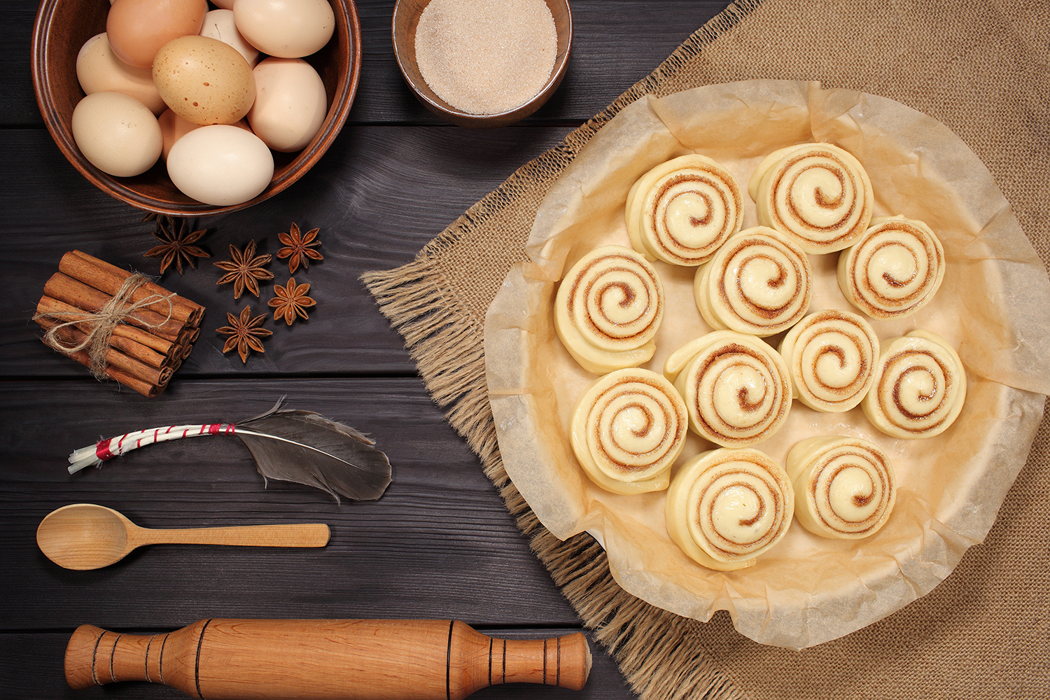 Set of 11 photos - raw buns: cinnamon rolls prepared for baking on a background of rustic table example image 8