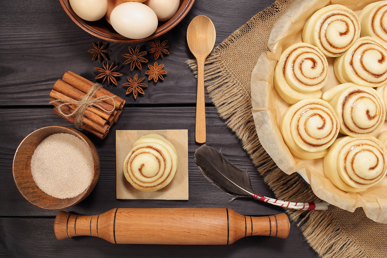 Set of 11 photos - raw buns: cinnamon rolls prepared for baking on a background of rustic table example image 16