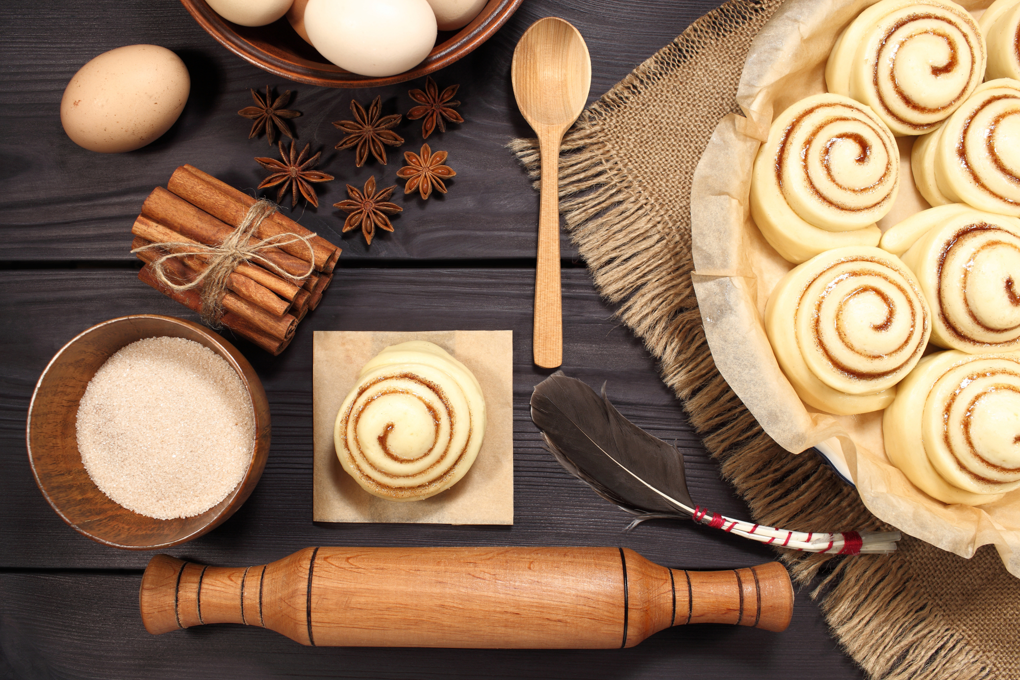 Set of 11 photos - raw buns: cinnamon rolls prepared for baking on a background of rustic table example image 6