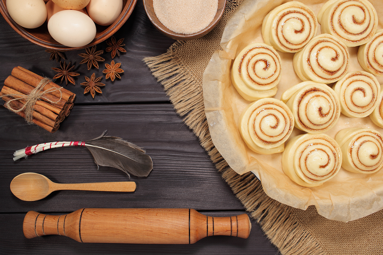 Set of 11 photos - raw buns: cinnamon rolls prepared for baking on a background of rustic table example image 9